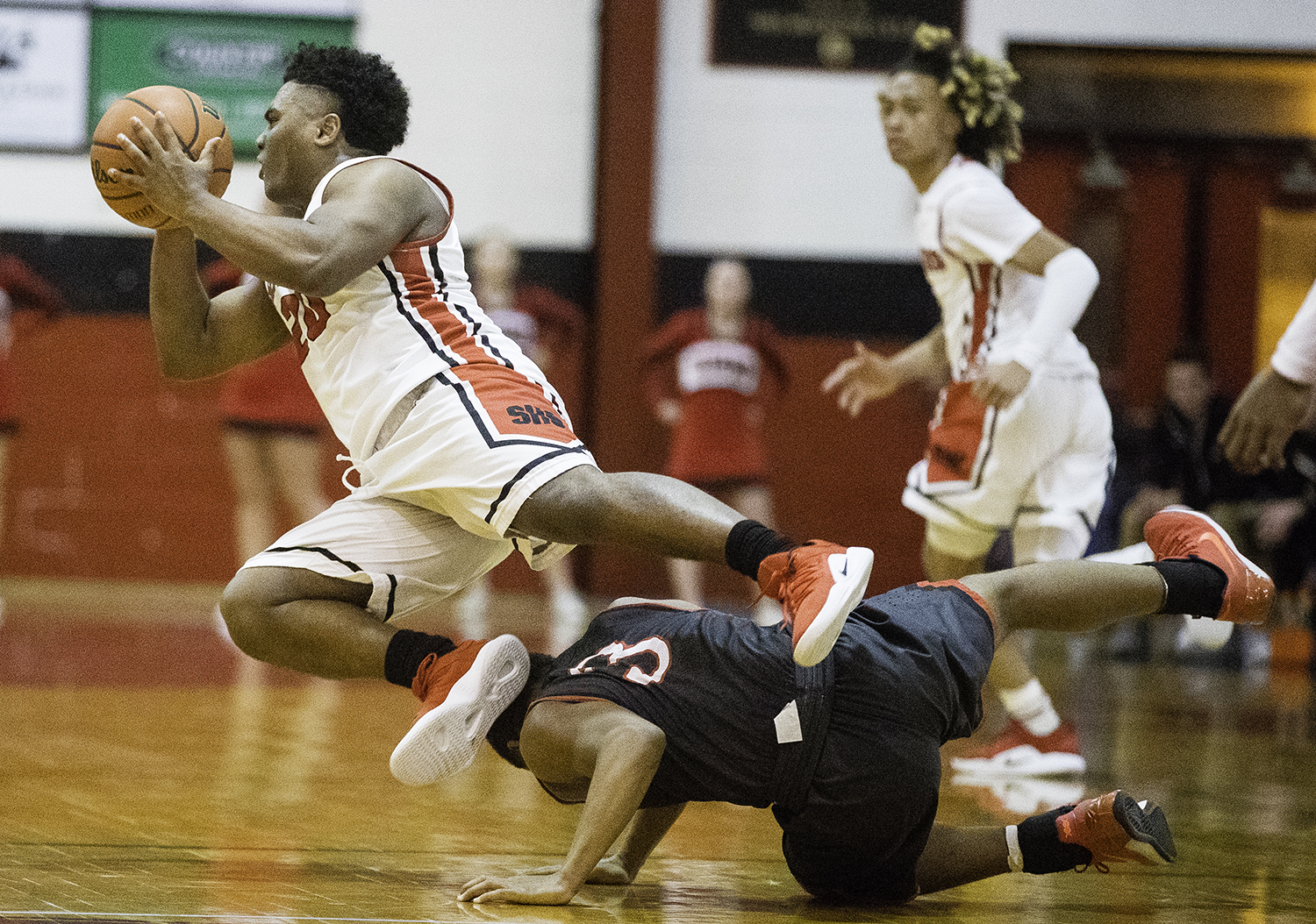 Springfield's Caleb Small is tripped up by Glenwood's Jason Hansbrough at Springfield High School Friday, Feb. 15, 2019. [Ted Schurter/The State Journal-Register]