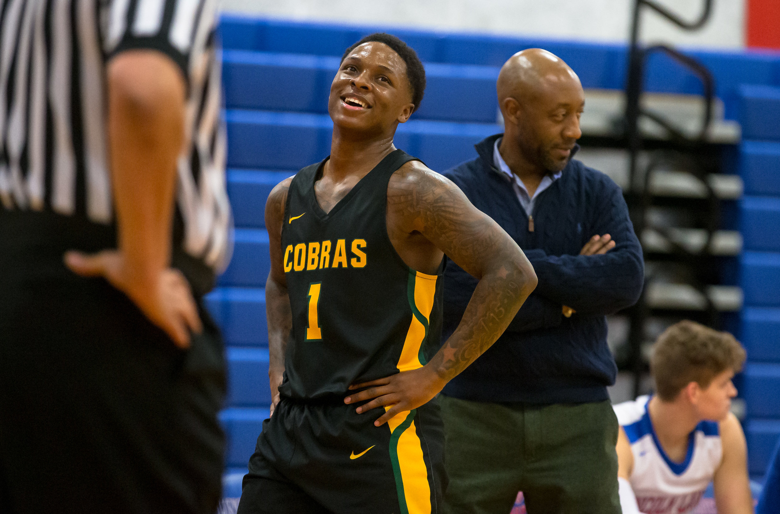 Parkland College's Yaakema Rose Jr. (1) jokes with Lincoln Land Community College men's basketball head coach Chuck Shanklin along the sidelines as the Cobras take on the Loggers in the first half at Lincoln Land Community College's Cass Gymnasium, Wednesday, Feb. 20, 2019, in Springfield, Ill. [Justin L. Fowler/The State Journal-Register]