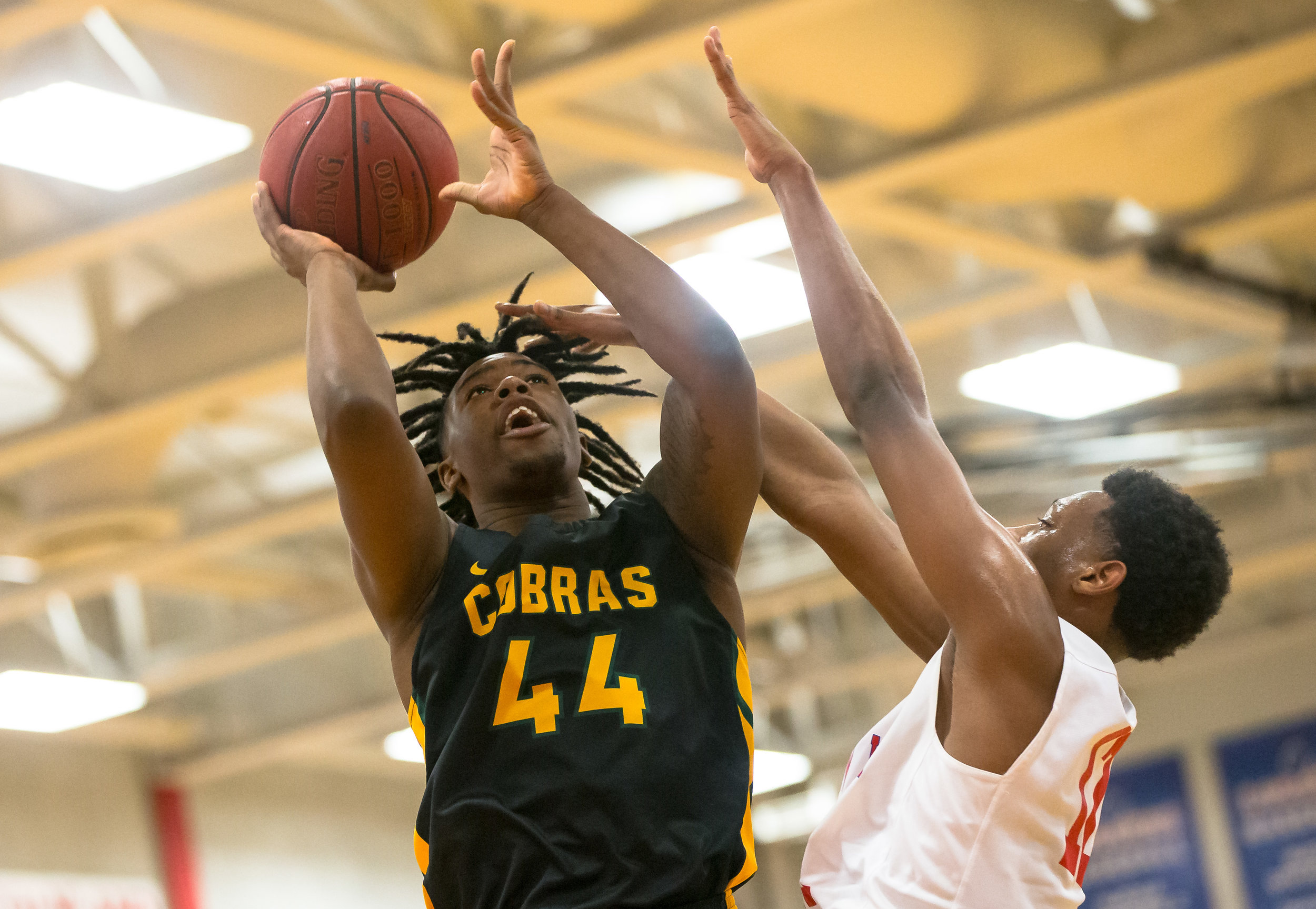 Parkland College's Bruno Williams Jr. (44) puts up a shot against Lincoln Land Community College's DJ Doolin (12) in the first half at Lincoln Land Community College's Cass Gymnasium, Wednesday, Feb. 20, 2019, in Springfield, Ill. [Justin L. Fowler/The State Journal-Register]