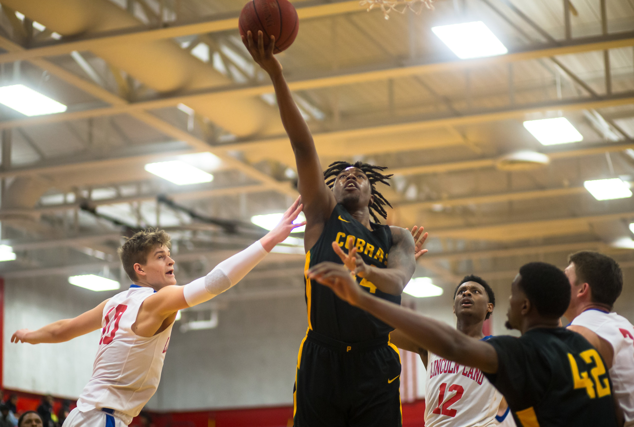 Parkland College's Bruno Williams Jr. (44) goes up for a basket against Lincoln Land Community College's Benji Eaker (10) in the second half at Lincoln Land Community College's Cass Gymnasium, Wednesday, Feb. 20, 2019, in Springfield, Ill. [Justin L. Fowler/The State Journal-Register]