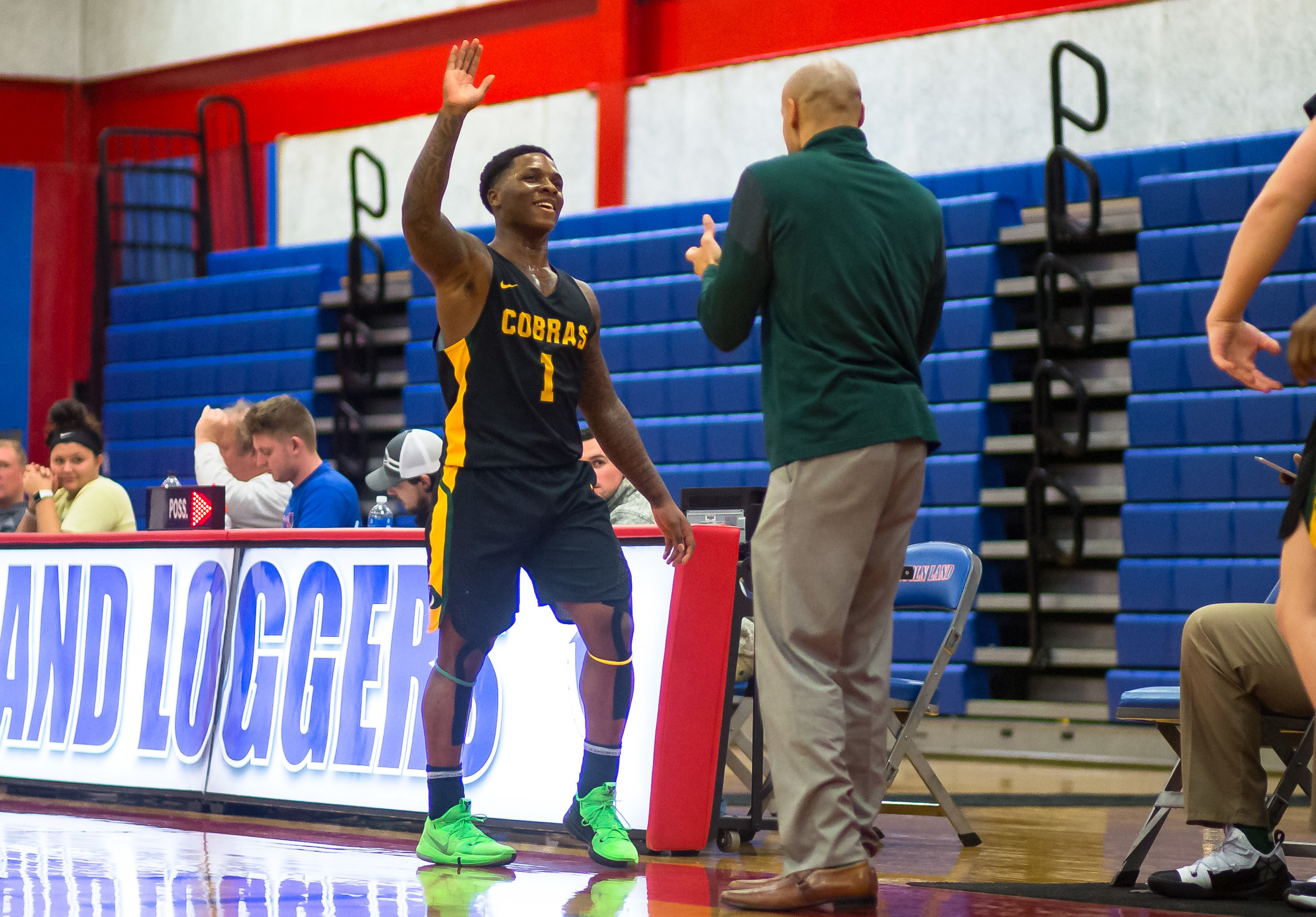 Parkland College's Yaakema Rose Jr. (1) gets a high five from Parkland College men's basketball head coach Anthony Figueroa as he comes off the floor as the Cobras take on Lincoln Land Community College in the second half at Lincoln Land Community College's Cass Gymnasium, Wednesday, Feb. 20, 2019, in Springfield, Ill. [Justin L. Fowler/The State Journal-Register]
