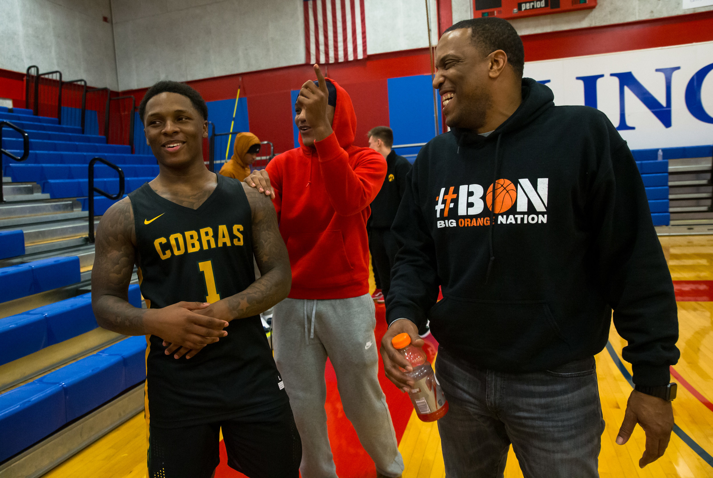 Parkland College's Yaakema Rose Jr. (1) visits with his former coach Blake Turner, right, and teammate Aundrae Williams, center, after the Cobras defeated Lincoln Land Community College 91-59 at Lincoln Land Community College's Cass Gymnasium, Wednesday, Feb. 20, 2019, in Springfield, Ill. [Justin L. Fowler/The State Journal-Register]