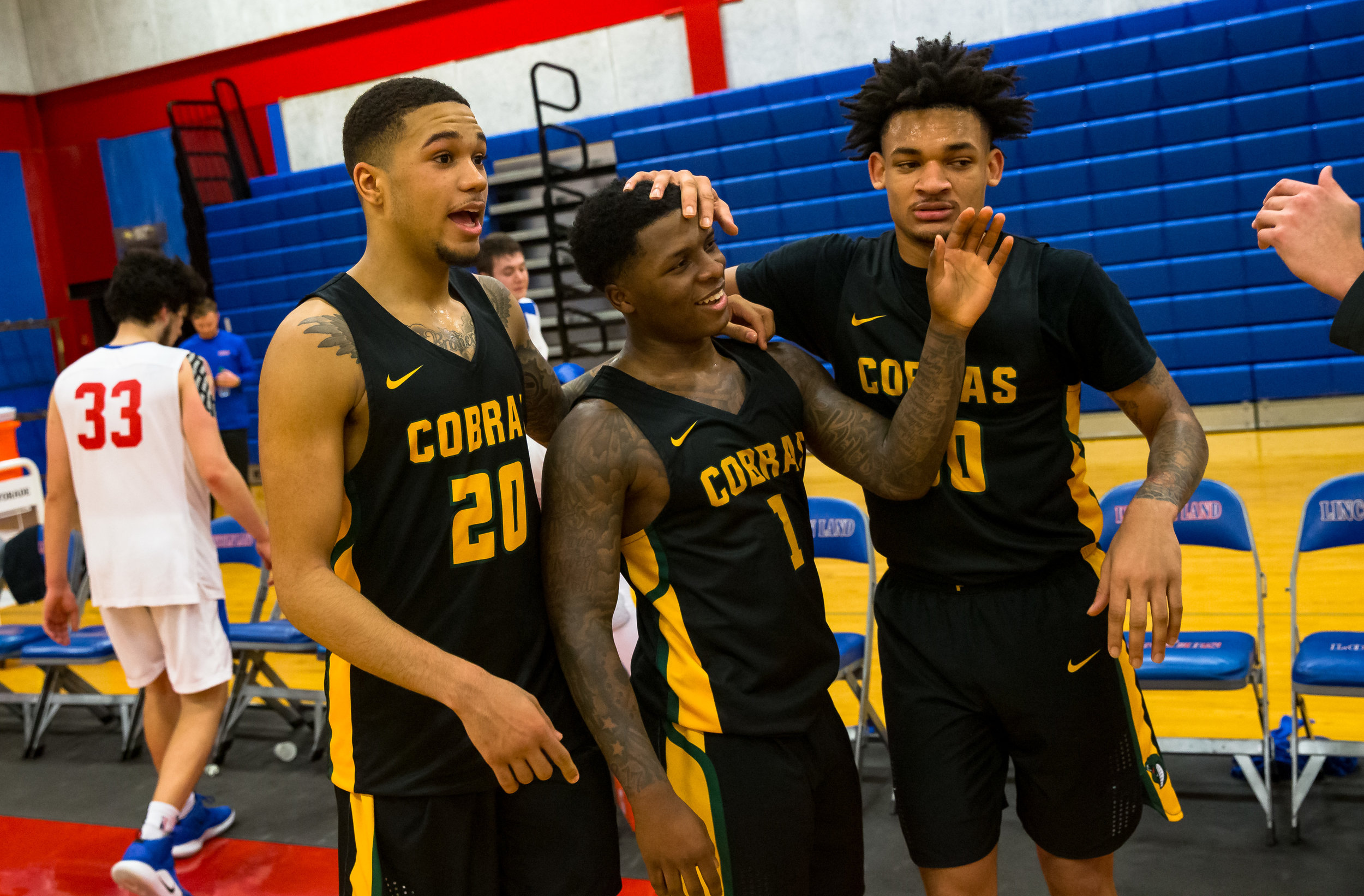 Parkland College's Yaakema Rose Jr. (1) celebrates with his teammates Parkland College's Carter Jeffries (20) and Parkland College's Ty Walter Jr. (30) after the Cobras defeated Lincoln Land Community College 91-59 at Lincoln Land Community College's Cass Gymnasium, Wednesday, Feb. 20, 2019, in Springfield, Ill. [Justin L. Fowler/The State Journal-Register]