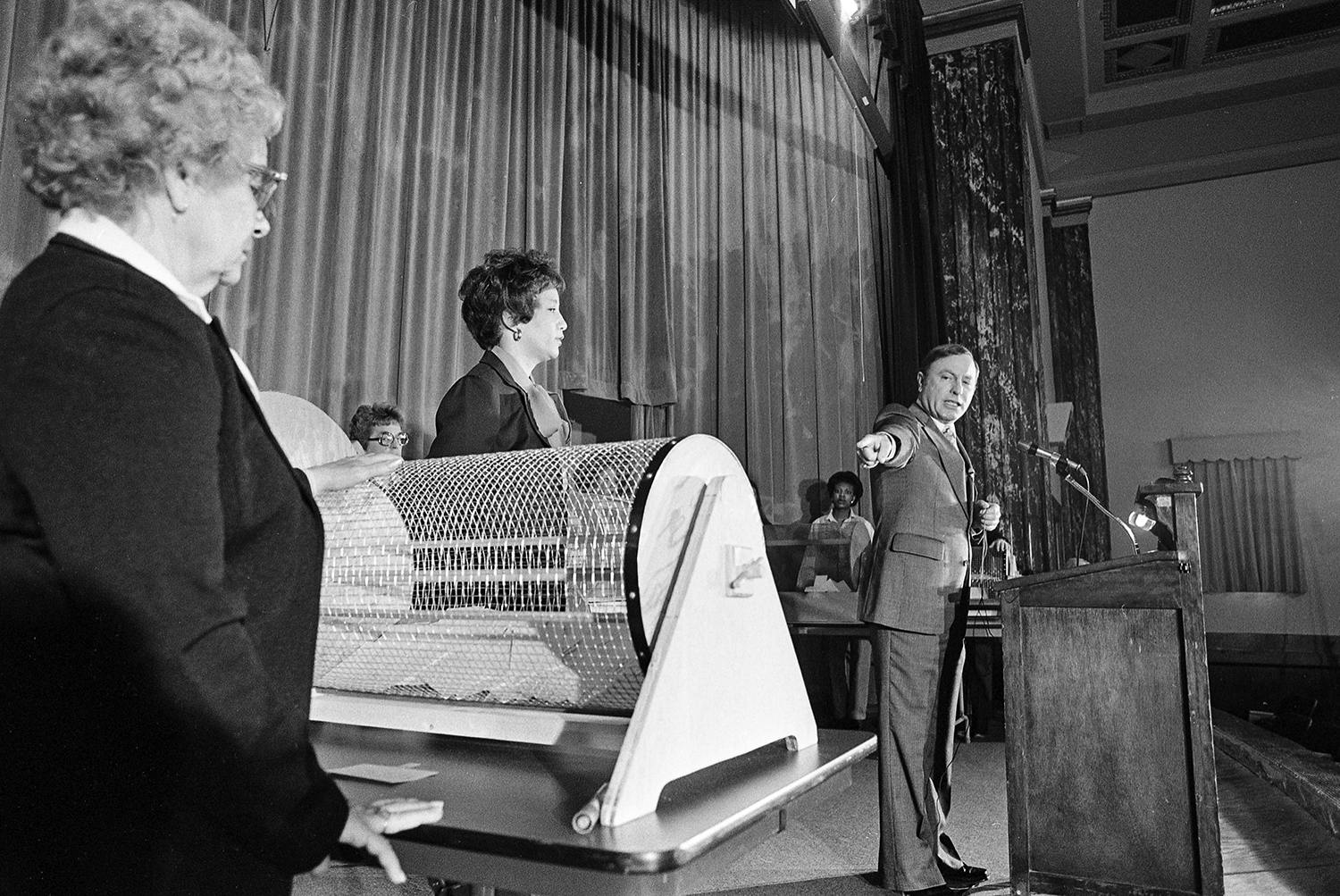 Illinois Secretary of State Alan Dixon draws names for new auto license vanity plates, Feb. 26, 1980. File/The State Journal-RegisterIllinois Secretary of State Alan Dixon draws winners for new state vanity plate designs, Feb. 26, 1980. File/Bill Hagen/The State Journal-RegisterPublished as Picturing the Past Feb. 17, 2019When the Illinois General Assembly approved a change in 1979 to expand the number of letters on a vanity plate from three to six, Secretary of State Alan Dixon�s office received 24,000 requests for the new plates. To prove that vane minds think alike, more than 14,000 of those were duplicate requests for the same combination of letters. To determine who won, Dixon and his staff held a drawing in the Howlett Building auditorium Feb. 26, 1980. Sixty eight motorists asked for �MIKE,� but only Michael LaSalle of Arlington Heights earned the right to his name alone on his license plate. The others had to settle for �MIKE 1,� and �MIKE 2,� all the way up to �MIKE 67.�Other popular plates included �DAVID,� �ROBERT,� �MARK,� �JOHN,� CAROL,� �BILL,� AND �IRISH.� The most coveted vanity plate among Illinoisans that year was not for someone, but rather, for something. More than 100 proud Corvette owners wanted �VETTE,� which was awarded to Suburban Welding and Manufacturing Inc. of Franklin Park. File/Bill Hagen/The State Journal-Register