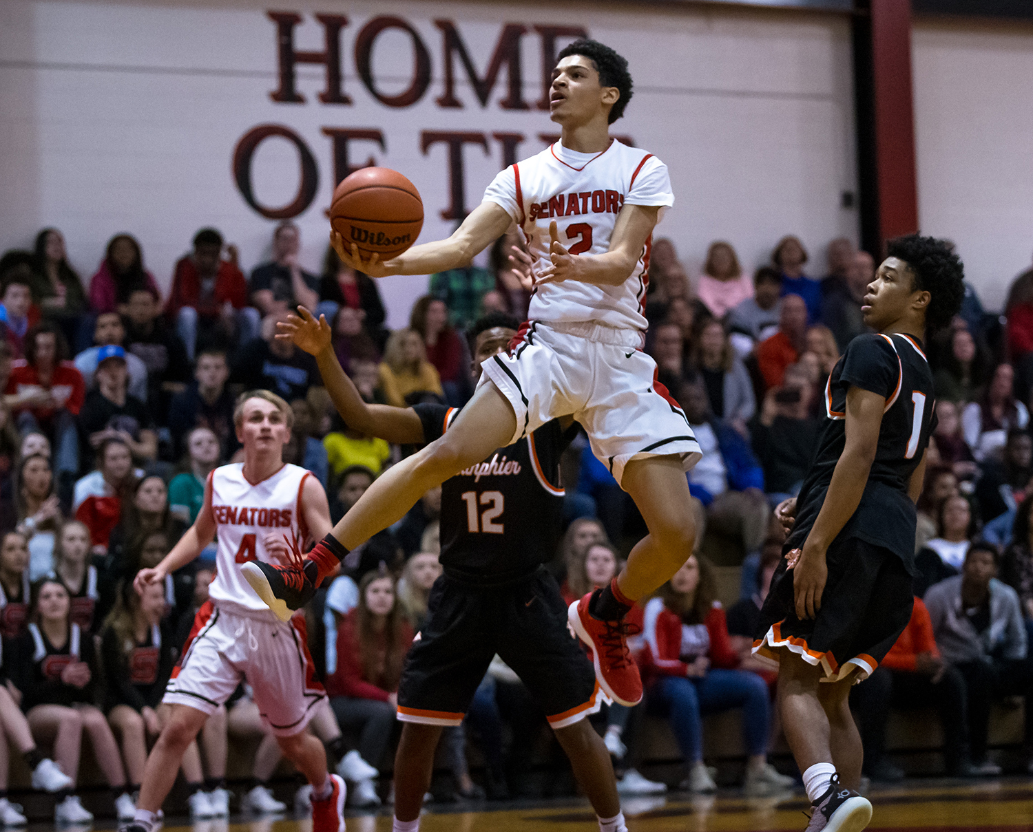 Springfield's Bennie Slater (2) goes up for a shot against Lanphier's Mehkii Phillips (1) in the first half at Springfield High School, Tuesday, Feb. 19, 2019, in Springfield, Ill. [Justin L. Fowler/The State Journal-Register]