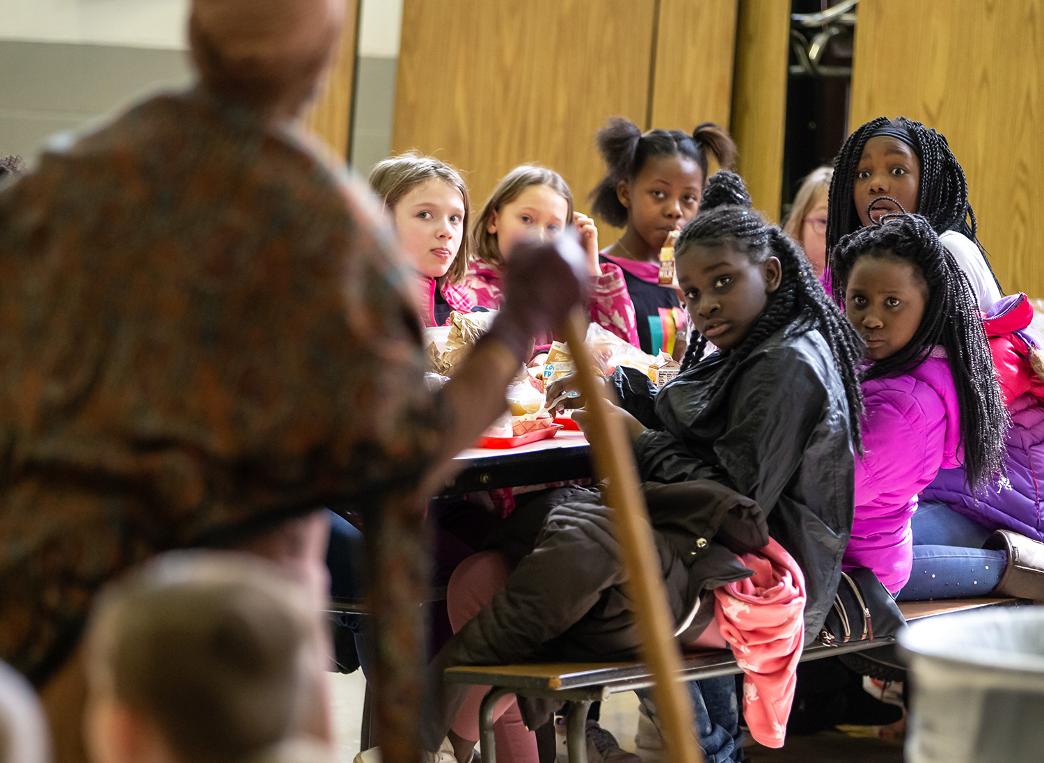 "Hazel Dell Elementary School students Nakyia Cooper, center, Sequoiyah Heidelberg and Amiah Alexander, right,  listen as Kathryn Harris, left, portraying Harriet Tubman, tells of Tubman's role in the Underground Railroad during a Black History Month program during the school's lunch hour, Thursday, Feb. 21, 2019, in Springfield, Ill. ""We want students to be aware of African American contributions to our society, which are often overlooked,"" said Principal Jamar Scott about the school's weekly Black History Month programs for their students. ""I think it's important that people know about Harriet Tubman and the work that she did because it's a part of American history not just African American history,"" said Kathryn Harris who has portrayed Tubman since the late 90s. ""Her story is timeless, the things that she did, her commitment to the cause of freedom, and we should all be committed, to making things better...that's what I like about Harriet Tubman."" [Justin L. Fowler/The State Journal-Register]"