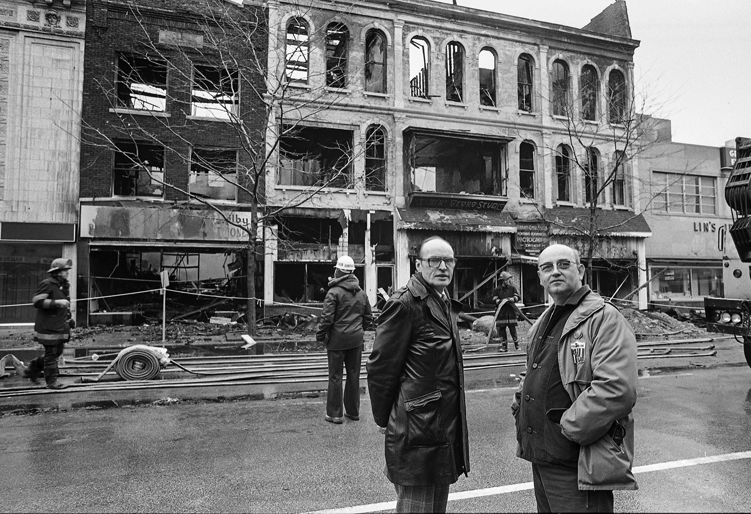 Fire destroys several downtown buildings at the intersection of Fifth and Monroe streets, including the Herbert Georg photography studio at 217 1/2 S. Fifth St., Feb. 19, 1980. The studio owners, Kenneth Carroll, left, and Don Ewing, at the scene of the fire. Photos by Chris Covatta and Bill Hagen (aftermath and cleanup) File/The State Journal-Register