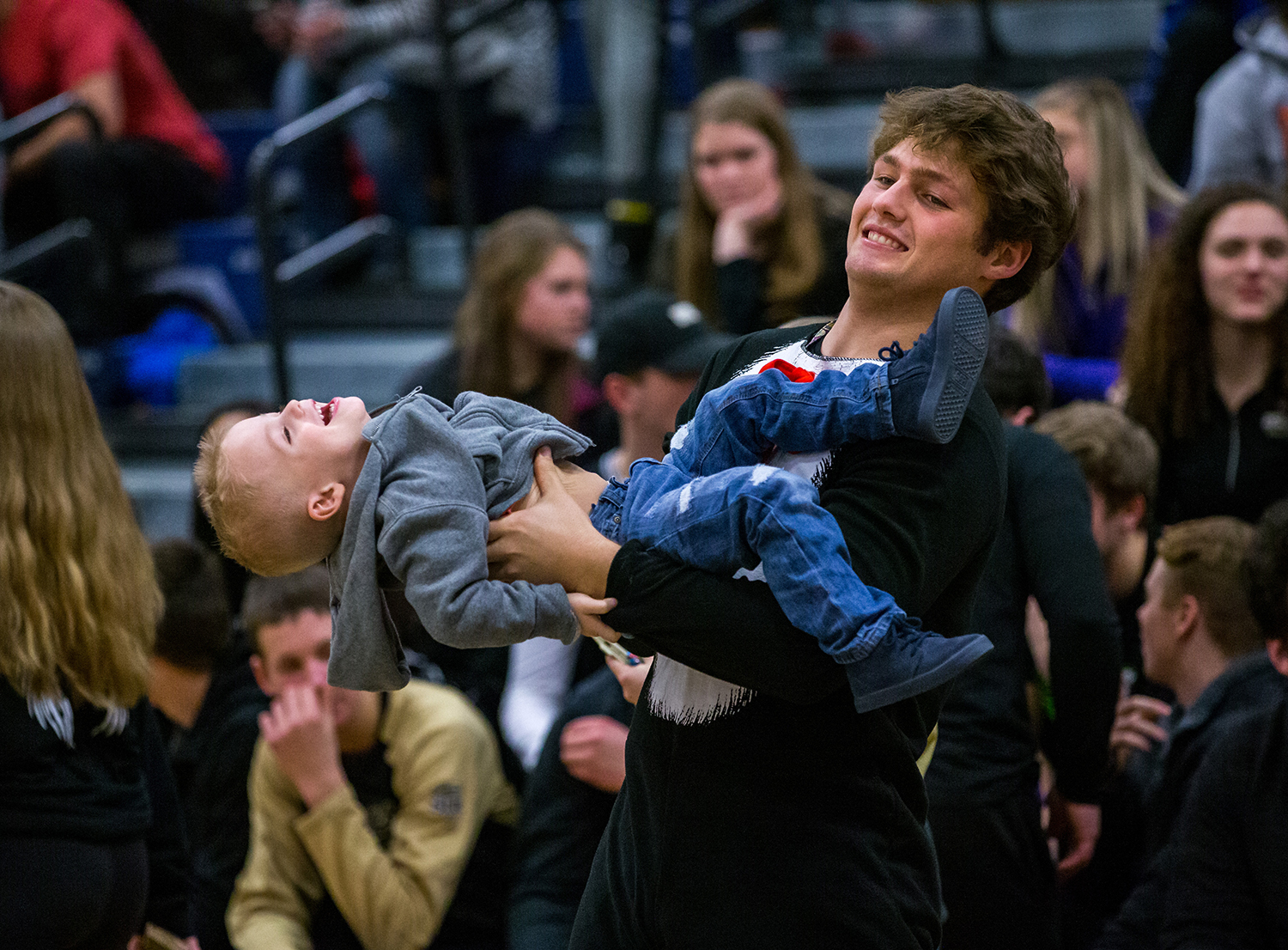 Sacred Heart-Griffin senior Matt Brenneisen spins his nephew, Jagger, 2, around in the air as he helps cheer on the Cyclones against Effingham in the second half during the Class 3A Springfield Supersectional at UIS' The Recreation and Athletic Center, Monday, Feb. 25, 2019, in Springfield, Ill. [Justin L. Fowler/The State Journal-Register]