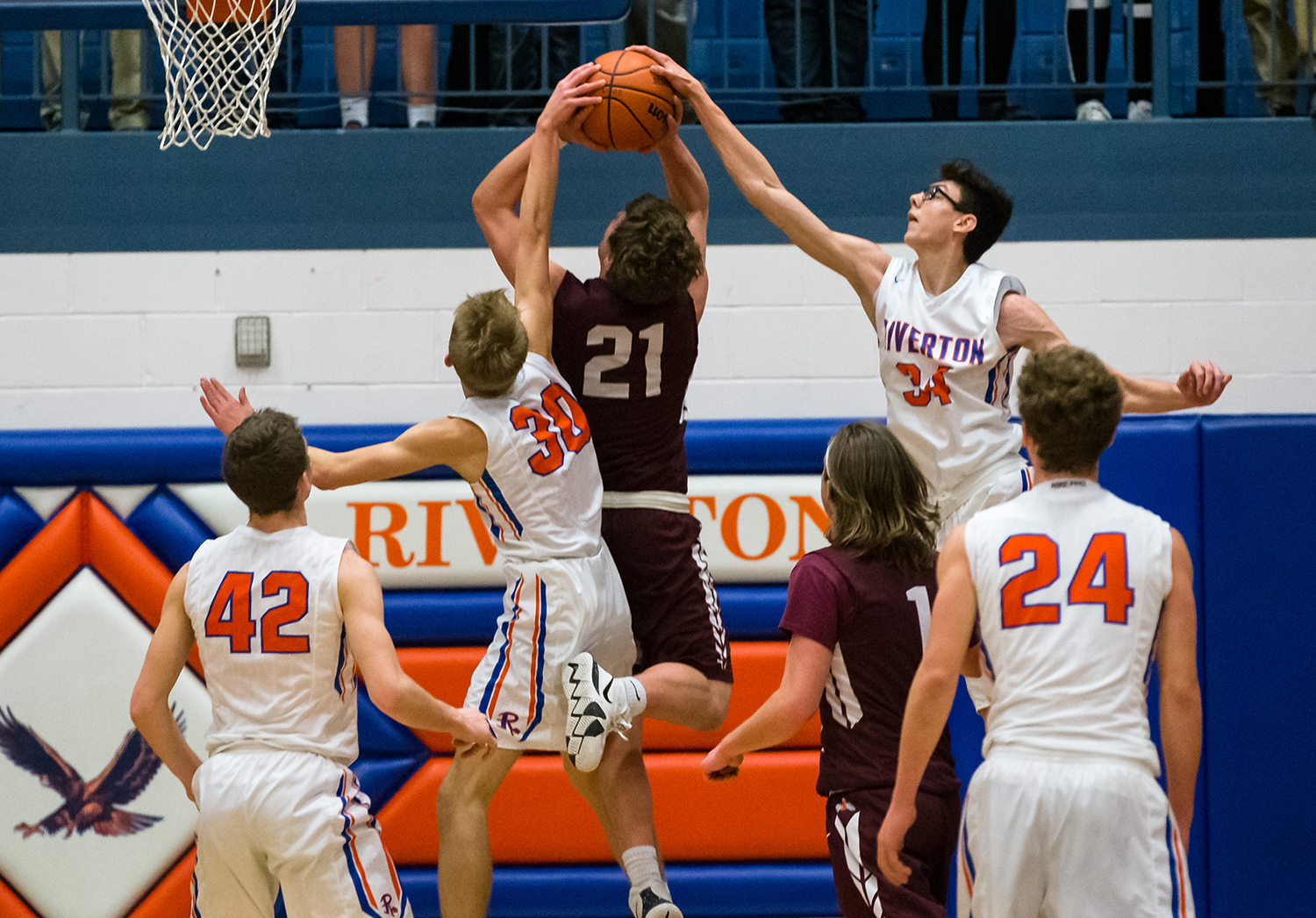 Riverton's Travis Hogan (34) and Riverton's Kaleb Rutter (30) combine to block a shot from Tremont's Ryan Wagenbach (21) in the first half during the Class 2A Riverton Sectional Semifinals at the Hawk Center, Tuesday, Feb. 26, 2019, in Riverton, Ill. [Justin L. Fowler/The State Journal-Register]