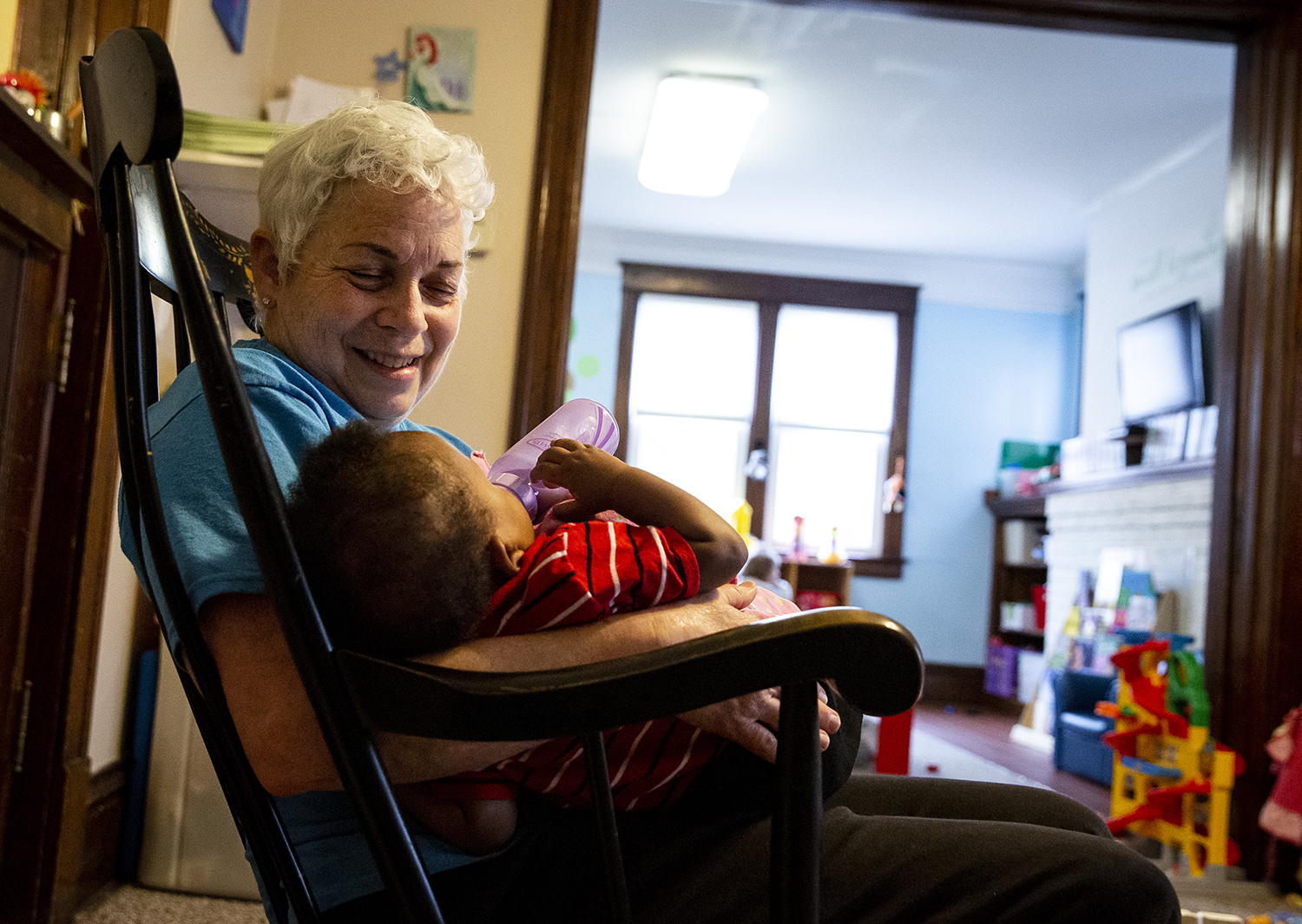 Beth Yong, a volunteer at the Mini O'Bierne Crisis Nursery for nearly 20 years, feeds an infant at the nursery Wednesday, Feb. 27, 2019 in Springfield, Ill. The nursery has announced a fundraising campaign to expand their long-time home on N. Seventh Street, or to find a new one. [Rich Saal/The State Journal-Register]