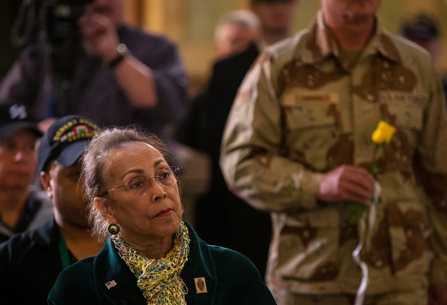 Phillipa Porter, the mother of Marine Lance Corporal Christian Porter who was killed in Operation Desert Storm, watches as yellow roses are presented during a memorial service for the 18 service members from Illinois that lost their lives during Operations Desert Storm and Desert Shield during the 28th annual Desert Storm Remembrance Ceremony hosted by the Illinois Department of Veterans' Affairs at the Illinois State Capitol, Thursday, Feb. 28, 2019, in Springfield, Ill. [Justin L. Fowler/The State Journal-Register]