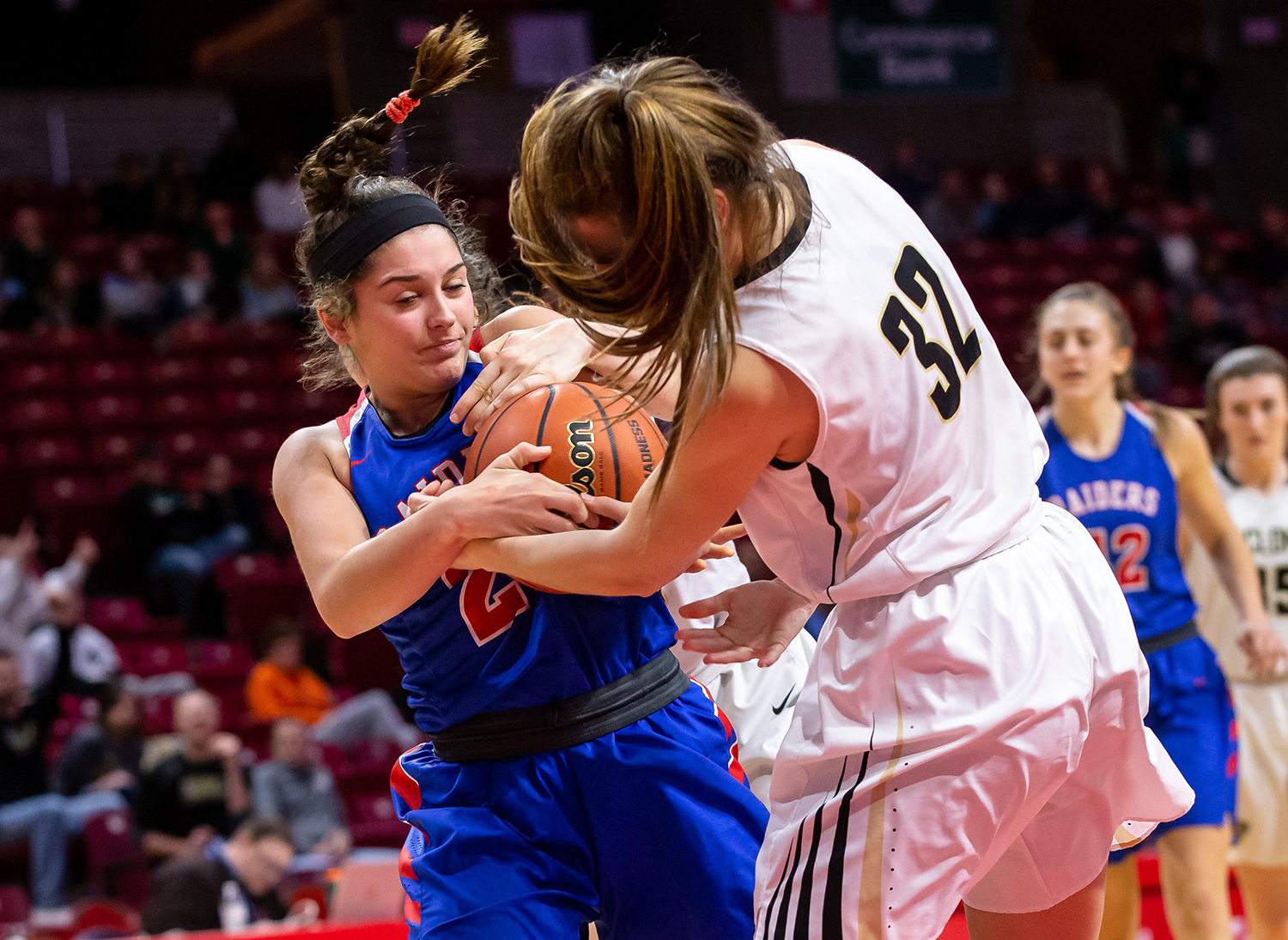 Glen Ellyn Glenbard South's Cat Karr (20) fights for possession of the ball against Sacred Heart-Griffin's Maddie Manker (32) in the fourth quarter during the IHSA Class 3A State Tournament semifinals at Redbird Arena, Friday, March 1, 2019, in Normal, Ill. [Justin L. Fowler/The State Journal-Register]