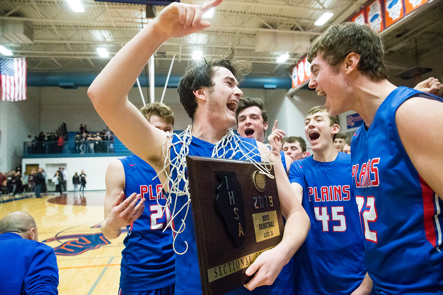 Pleasant Plains' Chase Schmitt celebrates with his teammates after the Cardinals defeated Tremont 61-41 during the Boys Class 2A Riverton Sectional at Riverton High School Friday, March 1, 2019. [Ted Schurter/The State Journal-Register]
