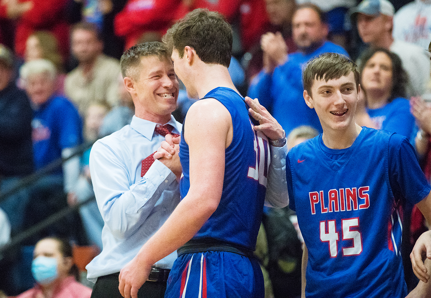 Pleasant Plains head coach Kyle Weber celebrates with Pleasant Plains' Joel Niermann during the Boys Class 2A Riverton Sectional at Riverton High School Friday, March 1, 2019. [Ted Schurter/The State Journal-Register]