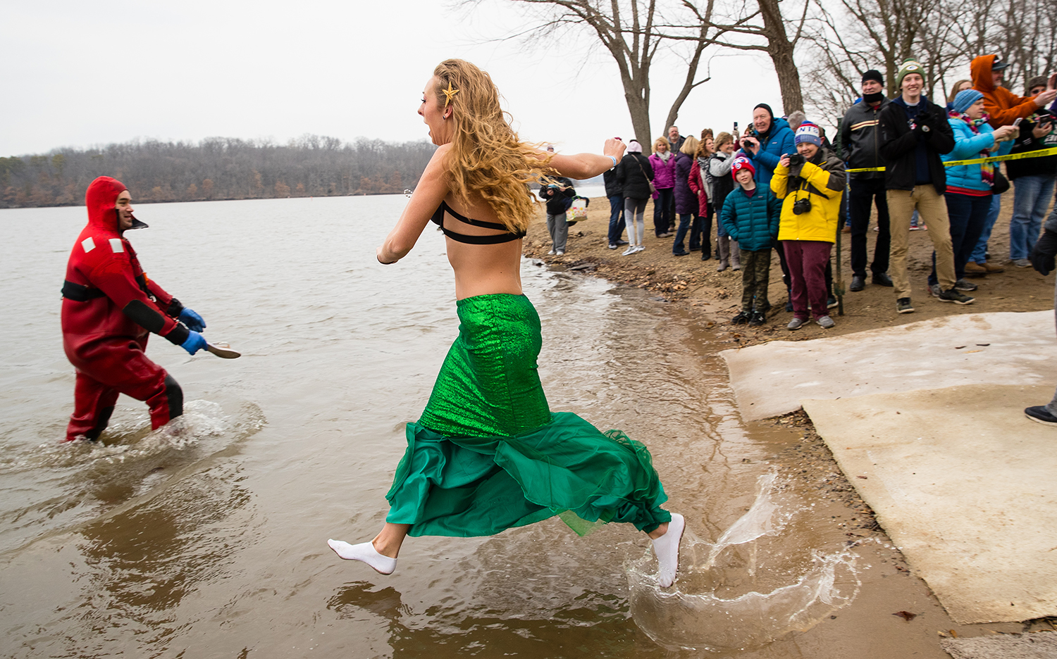 "Heidi Hayes, one of two members of the ""Ice Queens"" sprints into the water during the 2019 Polar Plunge benefiting the Special Olympics Illinois on Lake Springfield at the Knights of Columbus Lake Club Saturday, March 2, 2019. [Ted Schurter/The State Journal-Register]"