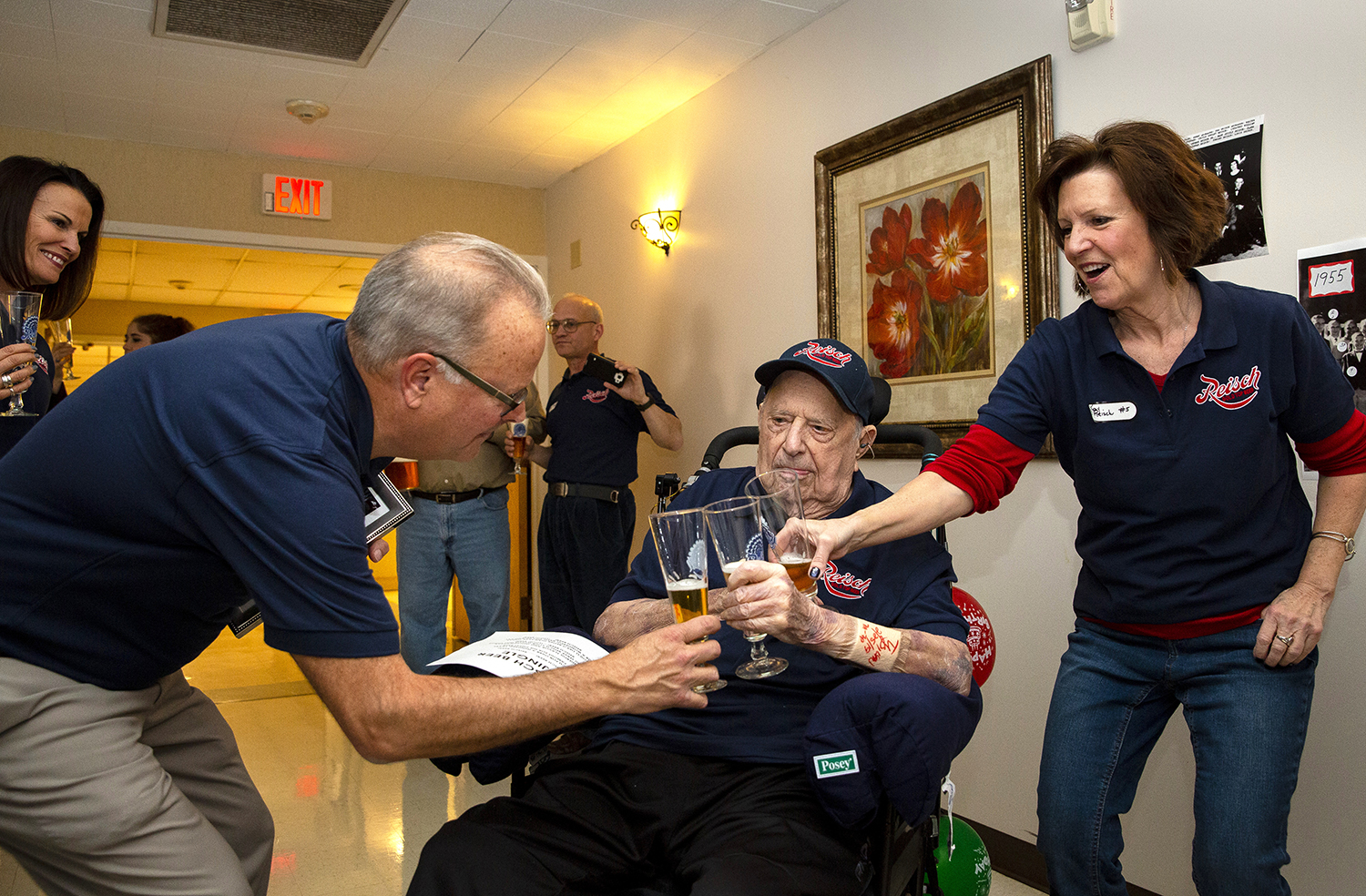 George Reisch and his sister, Kay, toast their dad, Ed Reisch, with Reisch Gold Top beer on his 100th birthday Saturday, March 2, 2019 at a health care facility near St. Louis, Mo. where his lives. Ed Reisch was the last brewmaster of the Reisch Brewing Co., once located on North Rutledge Street in Springfield, and a the re-release of the brewery's most popular beer was also part of the celebration. Ed Reisch got a sip for the first time in more than 50 years. [Rich Saal/The State Journal-Register]