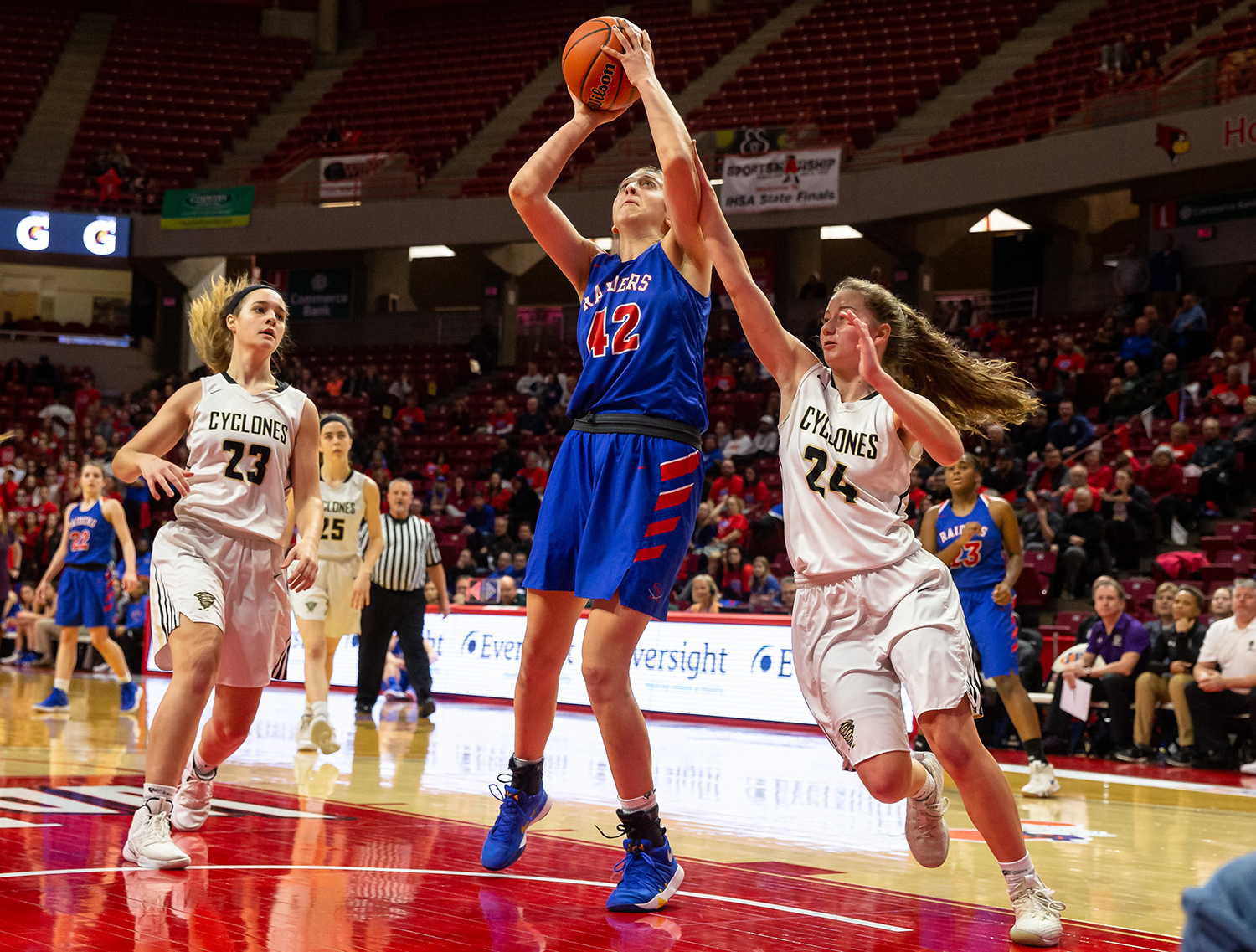 Glen Ellyn Glenbard South's Maggie Bair (42) goes up to the basket for a score against Sacred Heart-Griffin's Sofie Lowis (24) in the first quarter during the IHSA Class 3A State Tournament semifinals at Redbird Arena, Friday, March 1, 2019, in Normal, Ill. [Justin L. Fowler/The State Journal-Register]