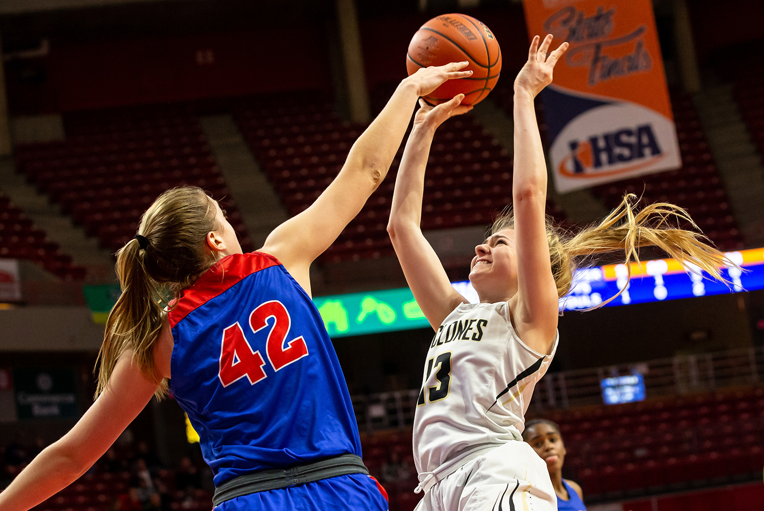 Sacred Heart-Griffin's Payton Vorreyer (13) gets her shot off under pressure from Glen Ellyn Glenbard South's Maggie Bair (42) in the fourth quarter during the IHSA Class 3A State Tournament semifinals at Redbird Arena, Friday, March 1, 2019, in Normal, Ill. [Justin L. Fowler/The State Journal-Register]