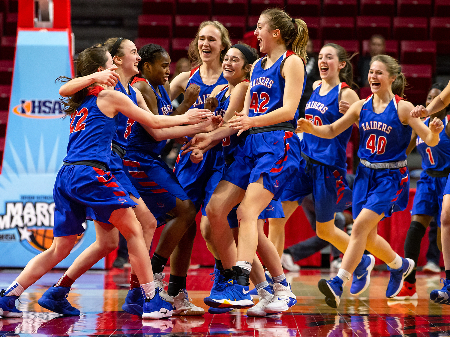 Glen Ellyn Glenbard South's Maggie Bair (42) and the Raiders celebrate after defeating Sacred Heart-Griffin 32-27 in the IHSA Class 3A State Tournament semifinals at Redbird Arena, Friday, March 1, 2019, in Normal, Ill. [Justin L. Fowler/The State Journal-Register]