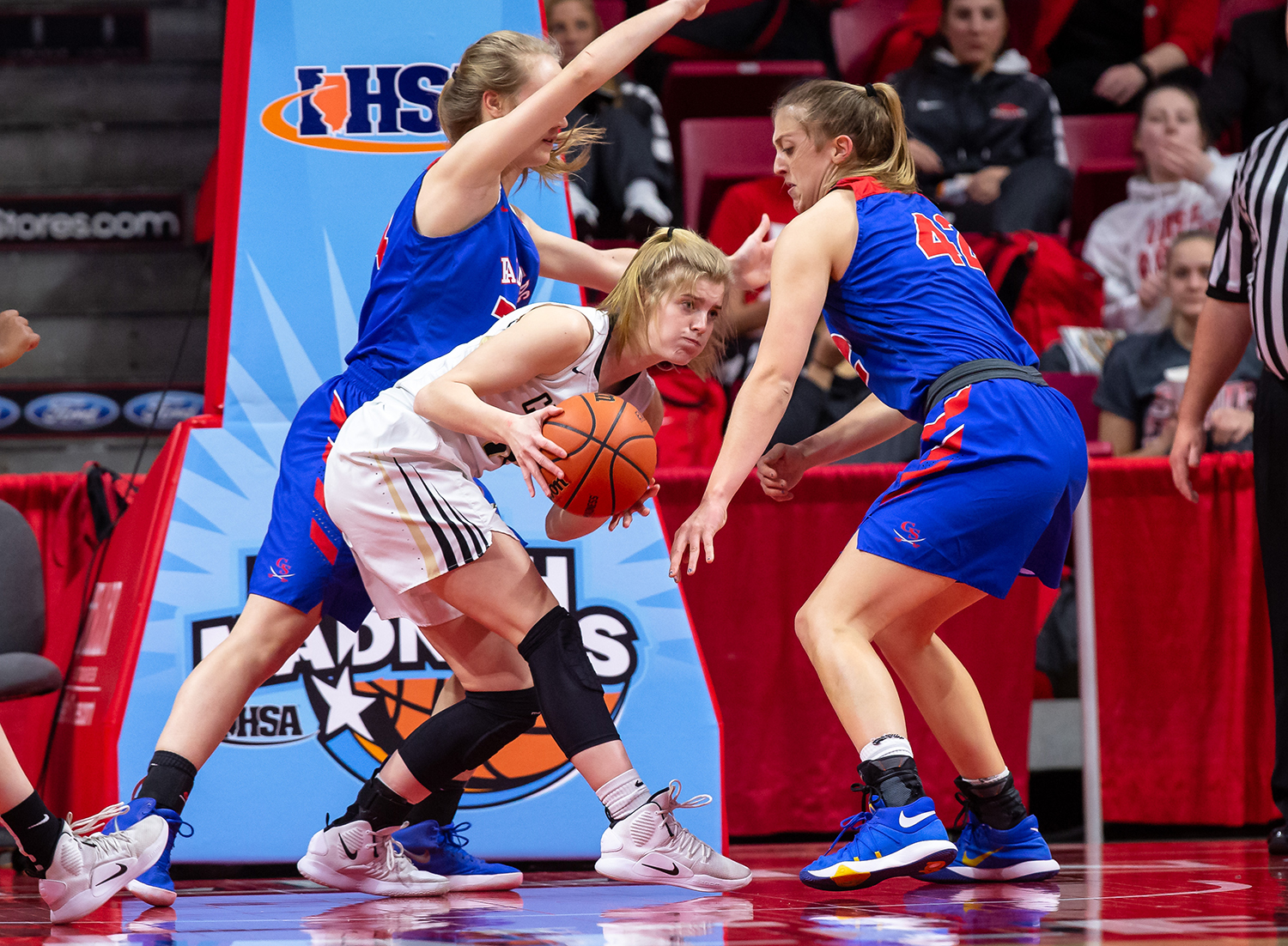 Sacred Heart-Griffin's Addison Scarlette (14) kicks a pass out to her teammates after an offensive rebound against Glen Ellyn Glenbard South's Maggie Bair (42) in the first quarter during the IHSA Class 3A State Tournament semifinals at Redbird Arena, Friday, March 1, 2019, in Normal, Ill. [Justin L. Fowler/The State Journal-Register]
