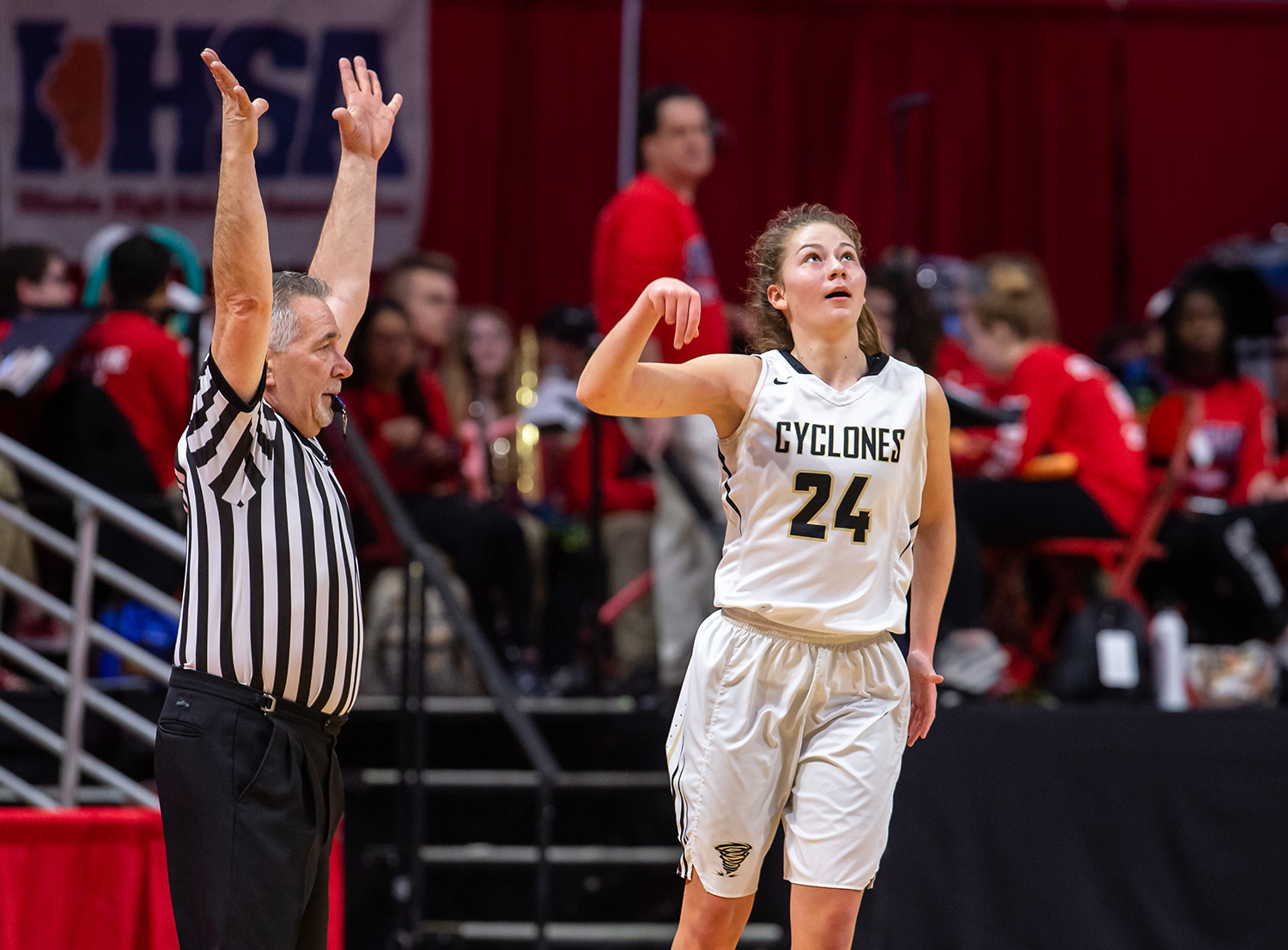 Sacred Heart-Griffin's Sofie Lowis (24) reacts after hitting a 3-pointer against Glen Ellyn Glenbard South in the first quarter during the IHSA Class 3A State Tournament semifinals at Redbird Arena, Friday, March 1, 2019, in Normal, Ill. [Justin L. Fowler/The State Journal-Register]
