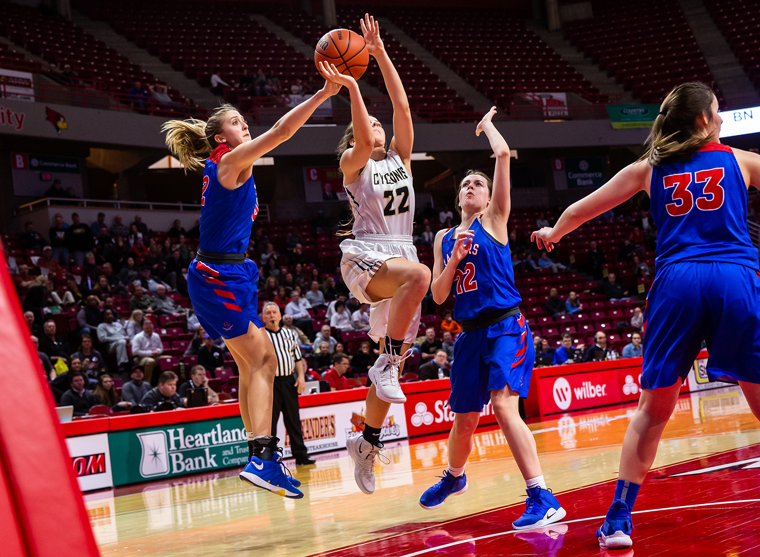 Glen Ellyn Glenbard South's Maggie Bair (42) blocks a shot from Sacred Heart-Griffin's Maggie Gilmore (22) in the fourth quarter during the IHSA Class 3A State Tournament semifinals at Redbird Arena, Friday, March 1, 2019, in Normal, Ill. [Justin L. Fowler/The State Journal-Register]