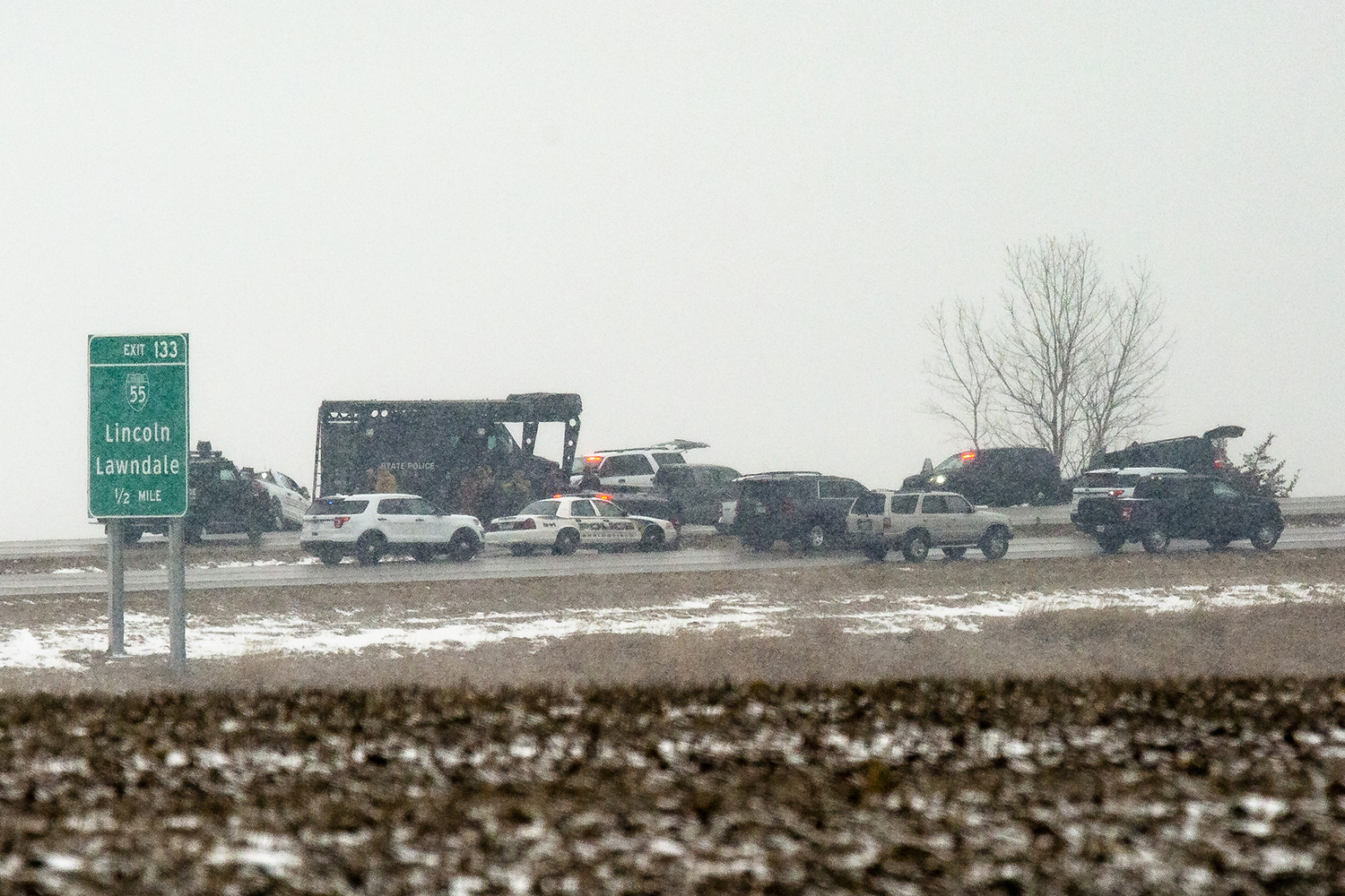 Illinois State Police and crisis negotiators are in a standoff with Floyd E. Brown, 39, of Springfield, on Interstate 55 near Lincoln, Ill. Thursday, March 7, 2019, after Brown allegedly shot a McHenry County sheriff's deputy attached to a U.S. Marshals Service task force in Rockford, then fled. His car was off the southbound lanes of the interstate and Brown was in and out of the car. [Rich Saal/The State Journal-Register]