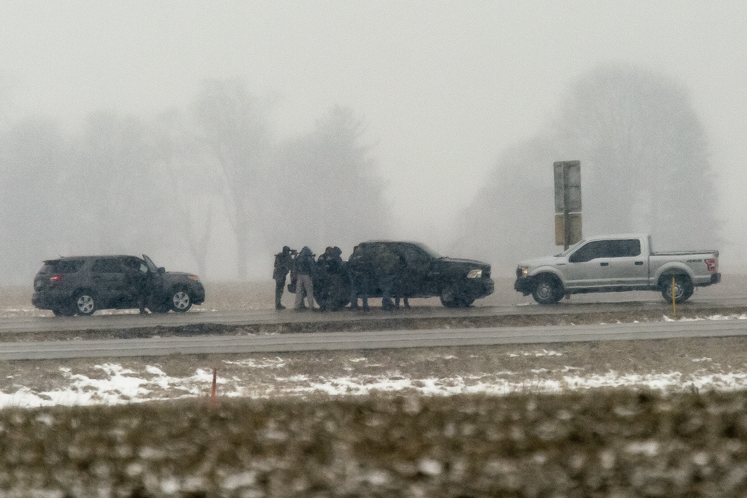 A police sharpshooter is in position where Illinois State Police and crisis negotiators are in a in a standoff with Floyd E. Brown, 39, of Springfield, on Interstate 55 near Lincoln Thursday, March 7, 2019, after Brown allegedly shot a federal agent in Rockford then fled. His car was off the southbound lanes of the interstate and Brown was in and out of the car. [Rich Saal/The State Journal-Register]
