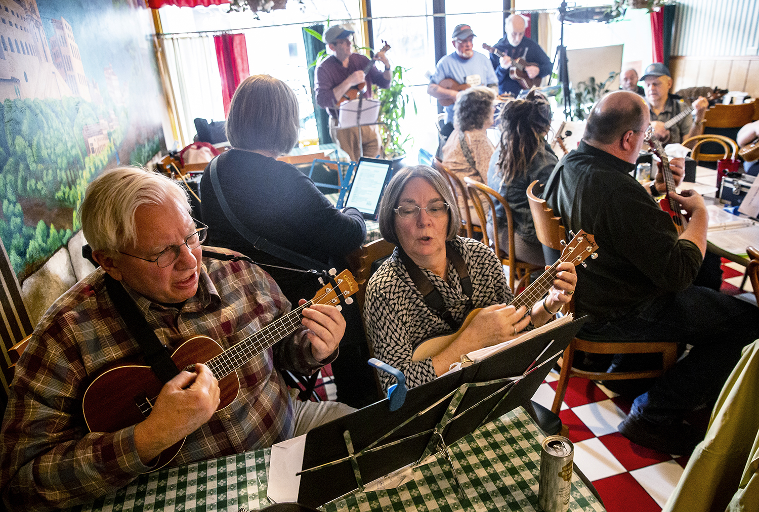 Keith MIller, left, and his his wife Bethany Spielman, right,  perform on the ukulele with the Springfield Uketopians during their monthly jam at Joe Gallina's Pizza, Saturday, March 9, 2019, in Springfield, Ill. This particular monthly jam was the groups sixth anniversary of coming together as a group to enjoy the ukulele and started with a group of five people that now has over 100 members. The Springfield Uketopians have members from all over the state that travel to sing and play the ukulele during their monthly jam on the second Saturday of each month at Joe Gallina's Pizza. [Justin L. Fowler/The State Journal-Register]