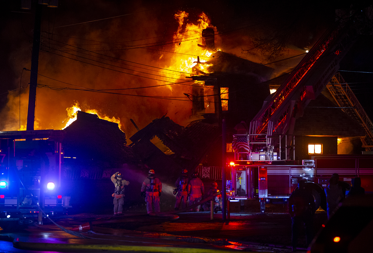 The Springfield Fire Department contends with sustained winds over 20 mph as they battle a structure fire that has fully engulfed a building at the corner of South Second Street and East Laurel Street, Sunday, March 10, 2019, in Springfield, Ill.