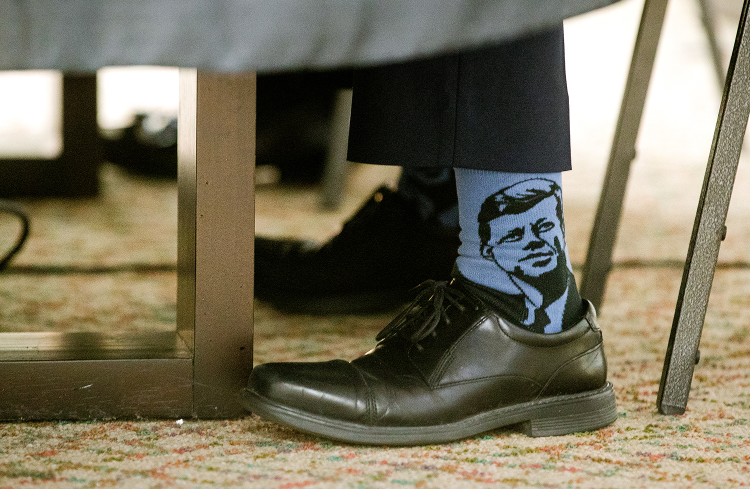 Springfield mayor Jim Langfelder sports a pair of socks with a likeness of President John F. Kennedy during a debate with Frank Edwards at the State Journal-Register Monday, March 11, 2019. [Ted Schurter/The State Journal-Register]