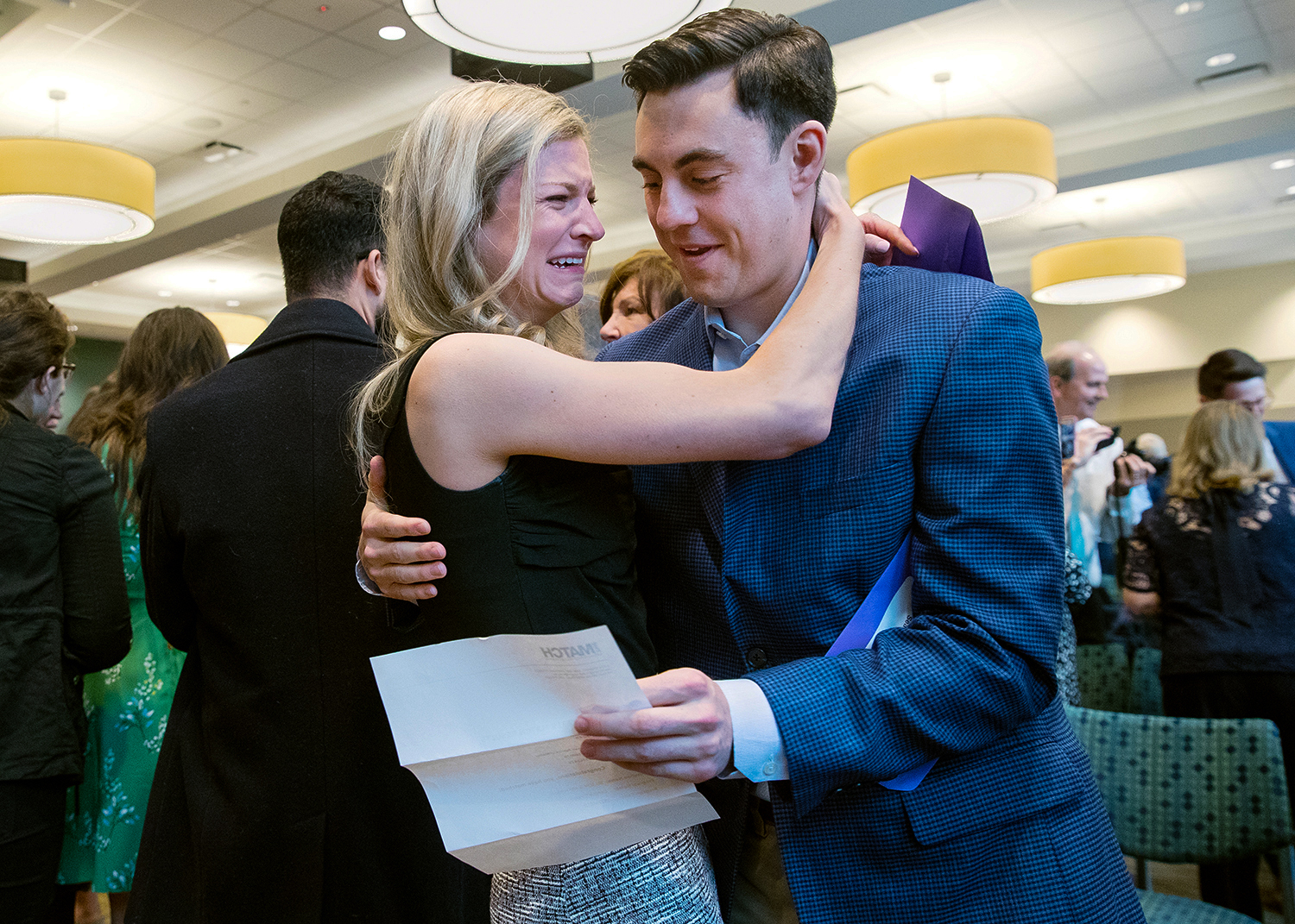 Springfield native Madelyn Fetter hugs her fiance Sean O'Malley after they learn they've been matched to Southern Illinois University School of Medicine and affiliated hospitals for their medical residencies during a Match Day ceremony at the Memorial Center for Learning and Innovation Friday, March 15, 2019. Sixty-three seniors at SIU School of medicine were part of more than 20,000 students nationwide who learned the results of the 2019 National Residency Match Program at the same time. Students will begin their residency training July 1, 2019. [Ted Schurter/The State Journal-Register]