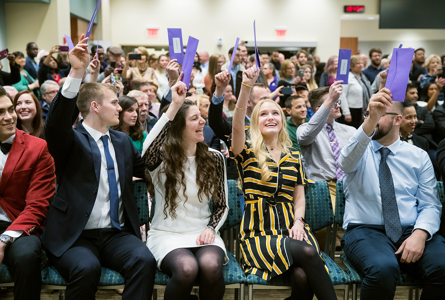 Southern Illinois University School of Medicine students hold up the purple envelopes that contain the names of the institutions where they'll spend their medical residency during a Match Day ceremony at the Memorial Center for Learning and Innovation Friday, March 15, 2019. Sixty-three SIU seniors were part of more than 20,000 students nationwide who learned the results of the 2019 National Residency Match Program at the same time. Students will begin their residency training July 1, 2019. [Ted Schurter/The State Journal-Register]