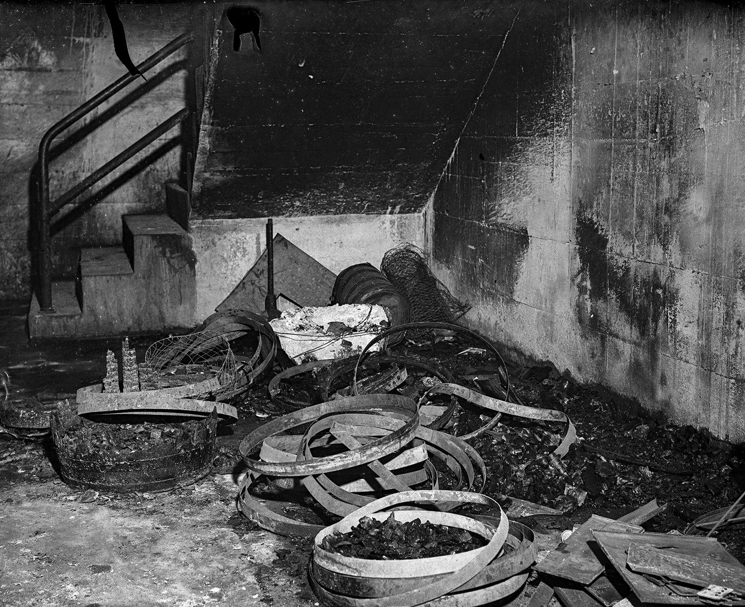 Debris is piled in a stairwell that led to the boiler room at Springfield High School where an explosion and fire killed three people, including two Springfield firefighters March 20, 1932. File/The State Journal-Register