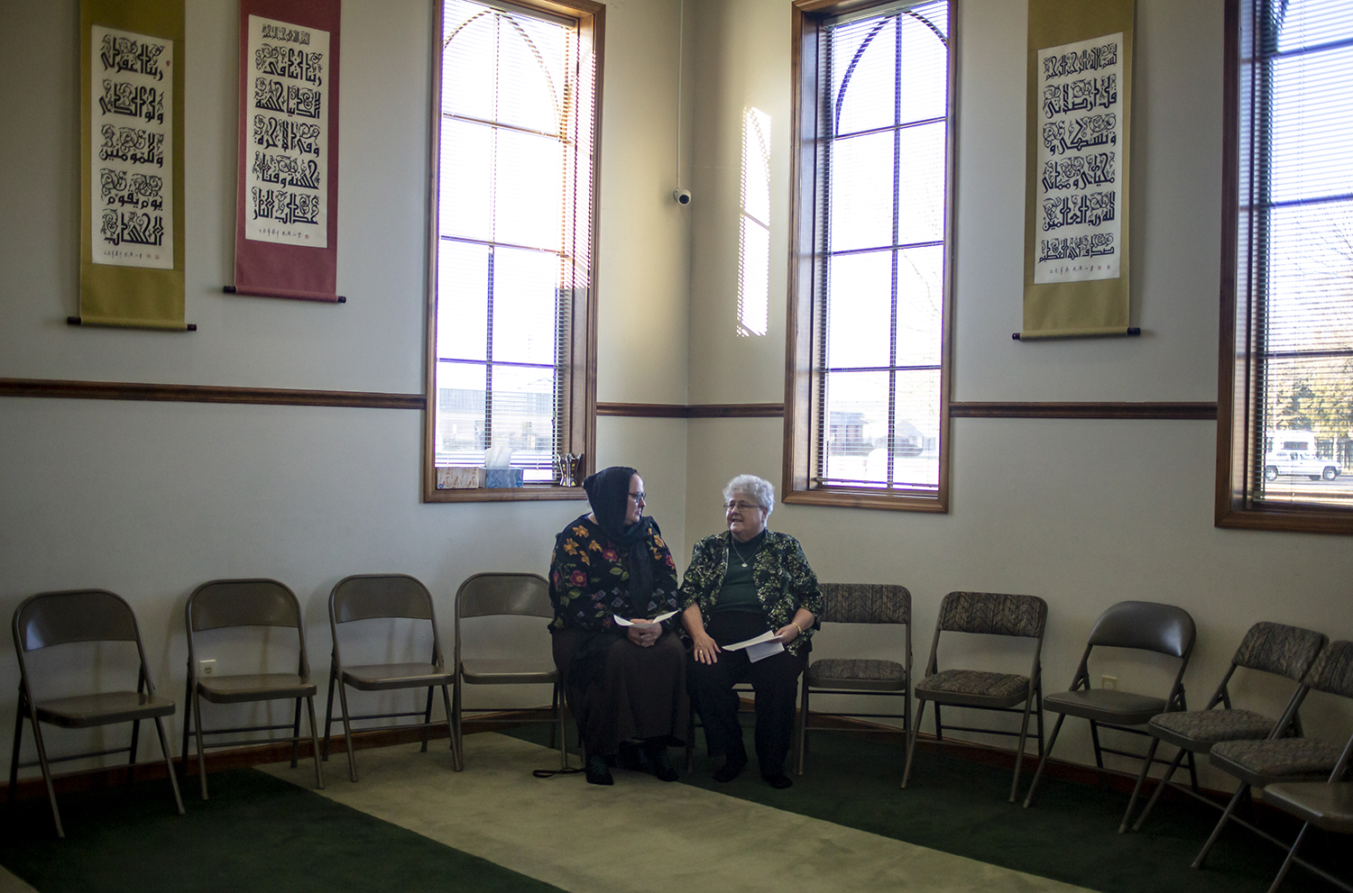 Rev. Dr. Bobbi Dykema, of the First Church of the Brethren, left, and Sister Barbara Blesse, of the Dominican Sisters of Springfield, visit with each other prior to the start of a vigil of solidarity & support for the Islamic community and the New Zealand shooting victims hosted by the Greater Springfield Interfaith Association and the Islamic Society Of Greater Springfield at the Islamic Society of Greater Springfield mosque, Sunday, March 17, 2019, in Springfield, Ill. [Justin L. Fowler/The State Journal-Register]