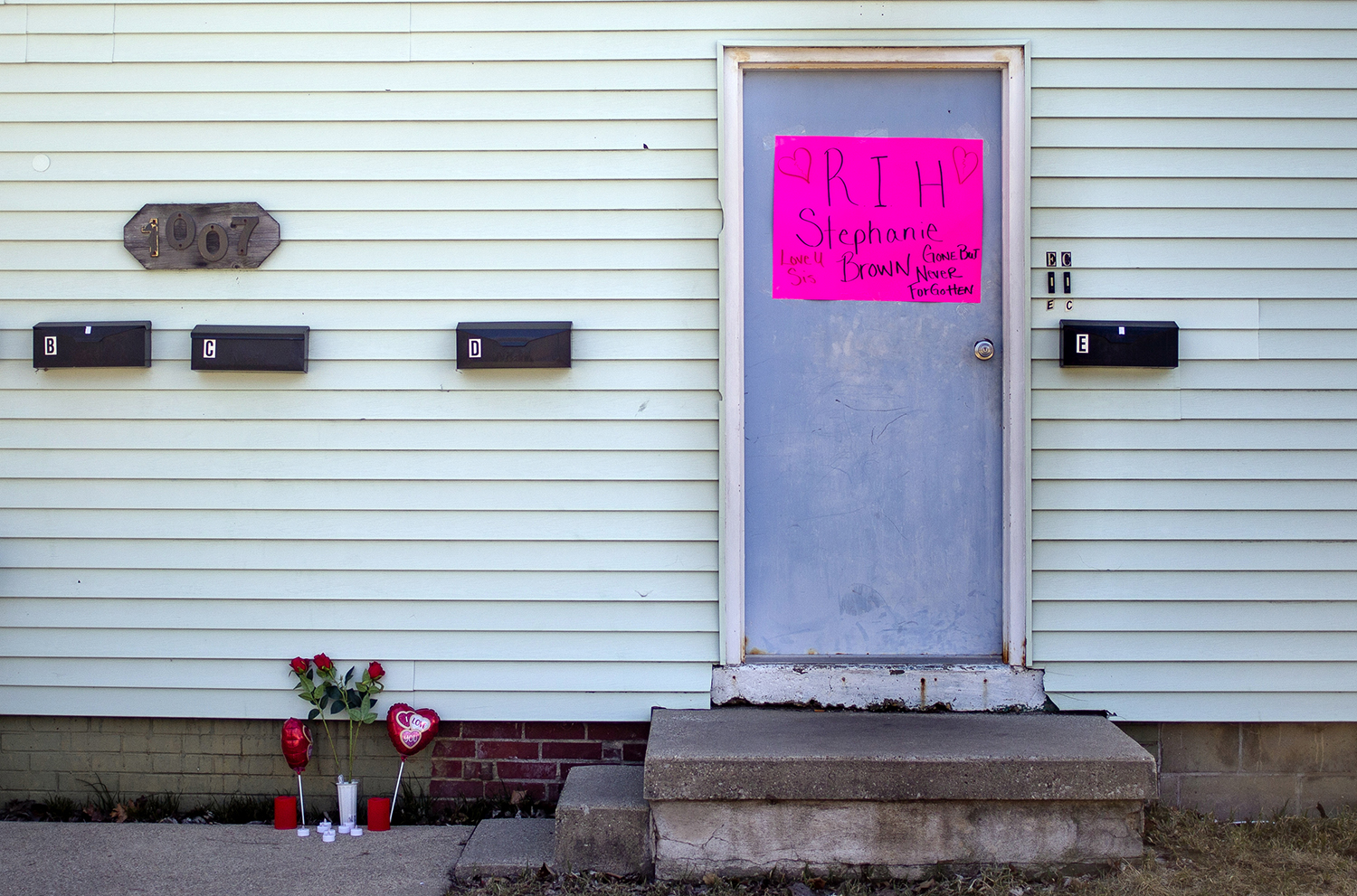 "A memorial for Stephanie Brown is setup next to the apartment building in the 1000 block of North Fourth Street where on Saturday she was found dead in an alleged homicide, Sunday, March 17, 2019, in Springfield, Ill. Springfield police initially were called to the apartment building on Saturday morning about another manner of death, but once officers arrived they deemed is was evident that there were ""suspicious circumstances"" around Brown's death. [Justin L. Fowler/The State Journal-Register]"
