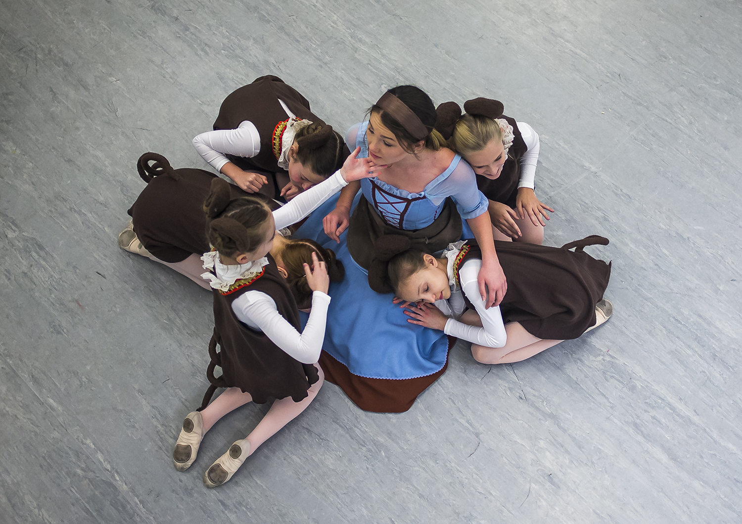 Olivia Pennell, as Cinderella, is surrounded by the mice during rehearsals for the Springfield Ballet Company's spring production of Cinderella at the Hoogland Center for the Arts, Sunday, March 17, 2019, in Springfield, Ill. [Justin L. Fowler/The State Journal-Register]