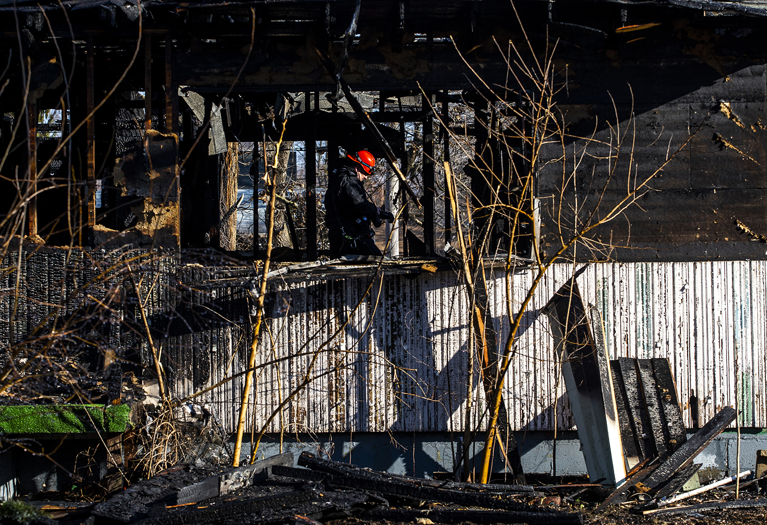 Fire investigators with the Springfield Fire Department go through the remnants of a residential structure destroyed in an early morning fire in the 2000 block of East Brown Street, Monday, March 18, 2019, in Springfield, Ill. [Justin L. Fowler/The State Journal-Register]