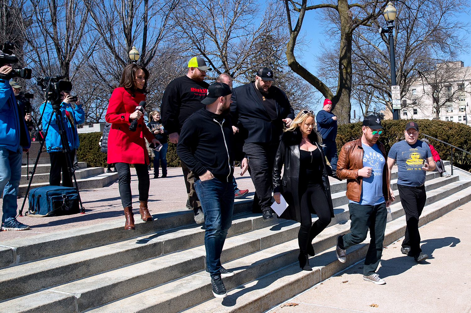 "Stormy Daniels leaves after addressing the media gathered at the Abraham Lincoln statue in front of the Illinois Capitol in Springfield, Ill. Friday, March 22, 2019. Daniels spoke out against the Live Adult Entertainment Facility Surcharge Act, a ""sin tax"" that was enacted in 2014, at the Illinois State Capitol. Daniels was in town to promote her memoir, ""Full Disclosure"" and appear at a Deja Vu Showgirls. [Ted Schurter/The State Journal-Register]"