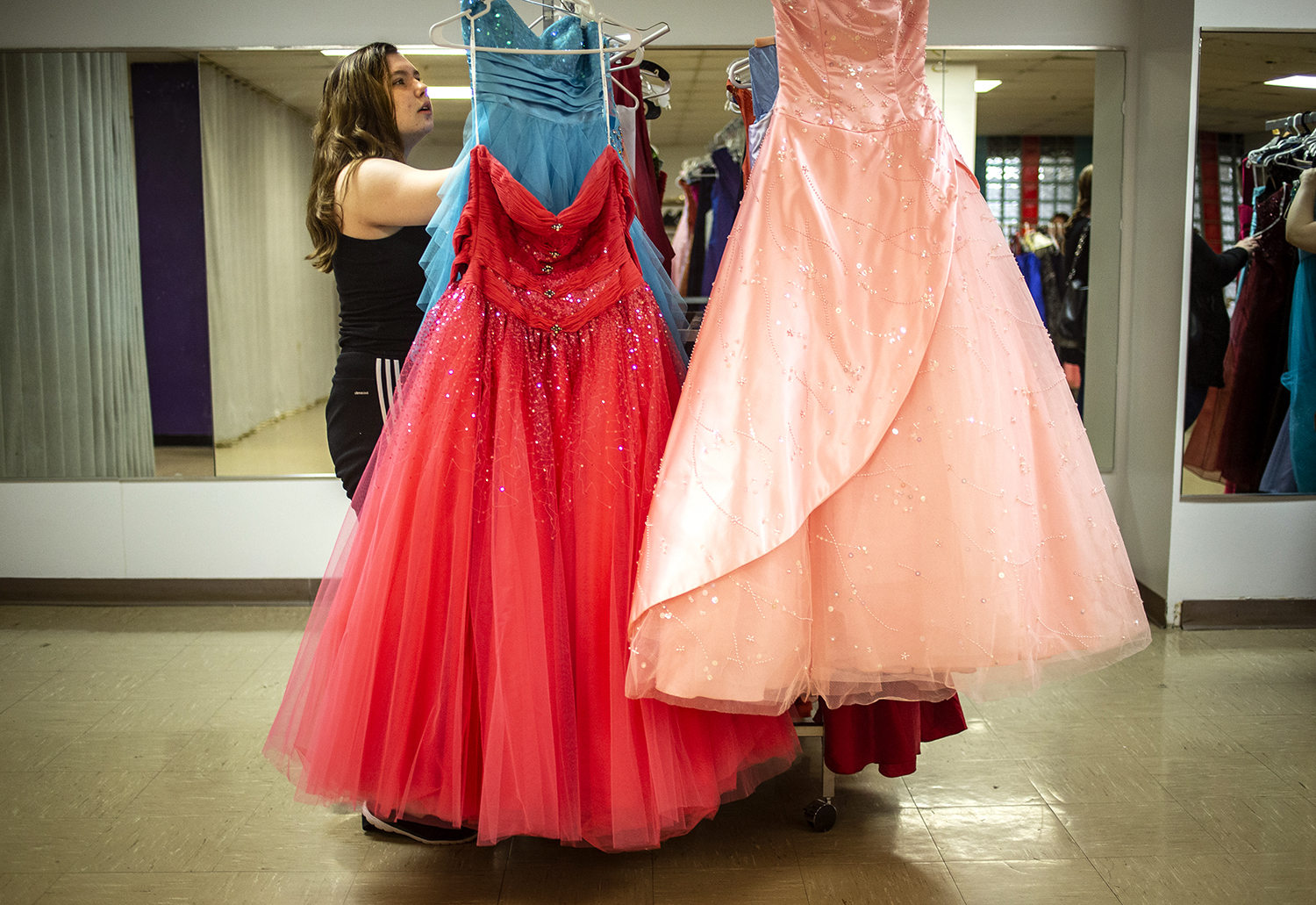 Marilyn Reid, 17, takes one last look through the rack after picking out a dress she liked during the YMCA of Springfield's Prom It Forward event at the Downtown YMCA, Sunday, March 24, 2019, in Springfield, Ill. The Prom It Forward program allows high school girls to purchase any gently used dress for a donation to the YMCA's Strong Kids Scholarship Fund. They will hold one more event for the season on April 28th and are also still accepting donations of dresses as well. [Justin L. Fowler/The State Journal-Register]
