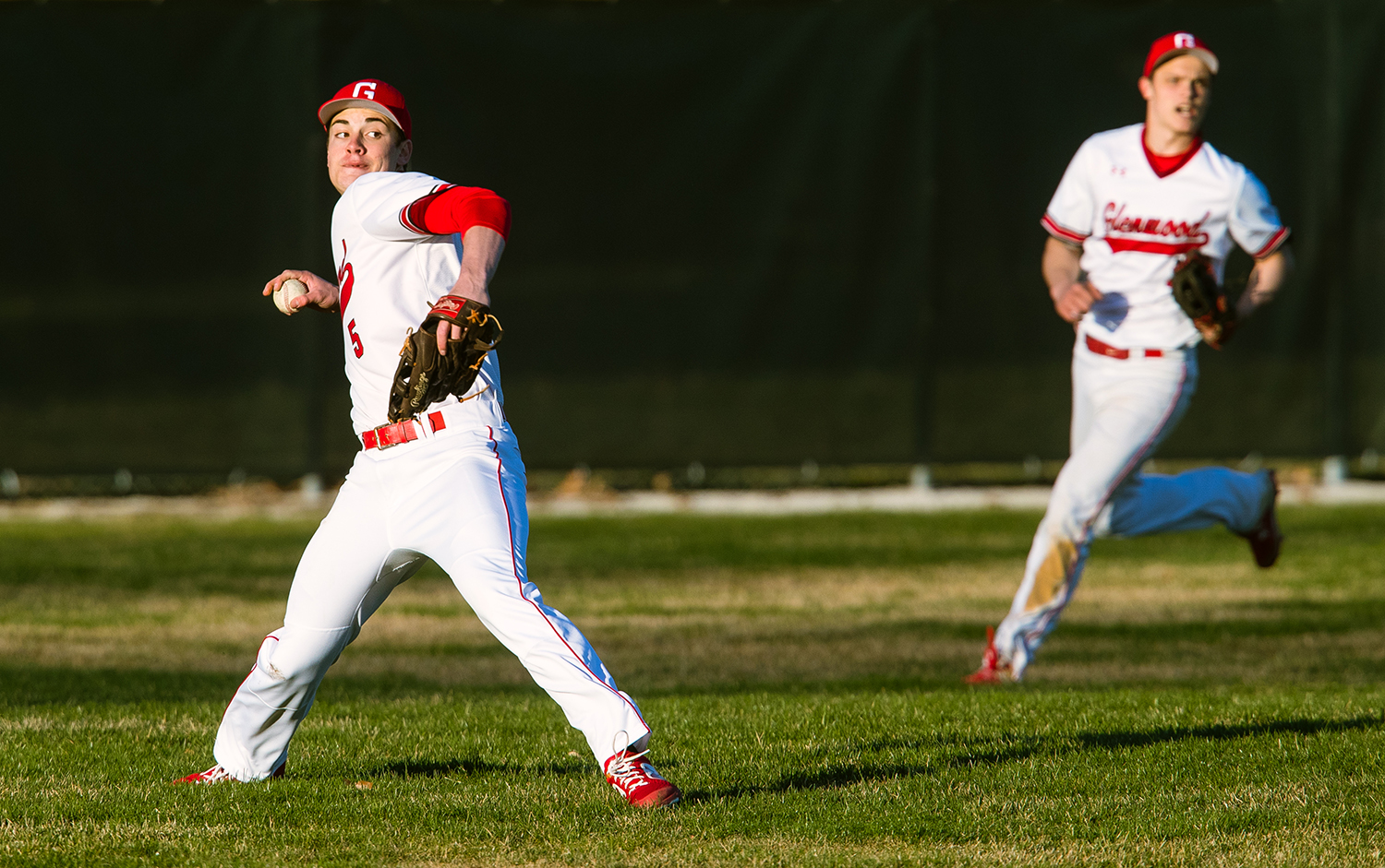 Glenwood's Jalen Ping throws the ball back to the infield after a U-High hit at Chatham Community Park's Bob Erickson Field Monday, March 26, 2019. [Ted Schurter/The State Journal-Register]