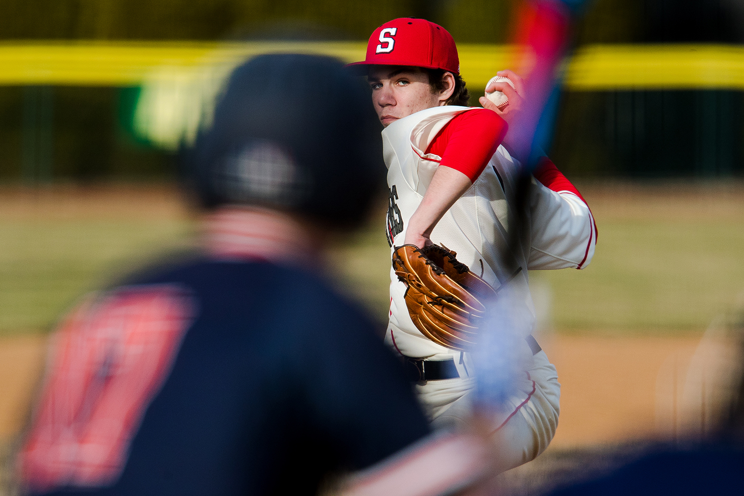 Springfield's Adam Passmore delivers a pitch to Rochester at Robin Roberts Stadium Wednesday, March 27, 2019. [Ted Schurter/The State Journal-Register]