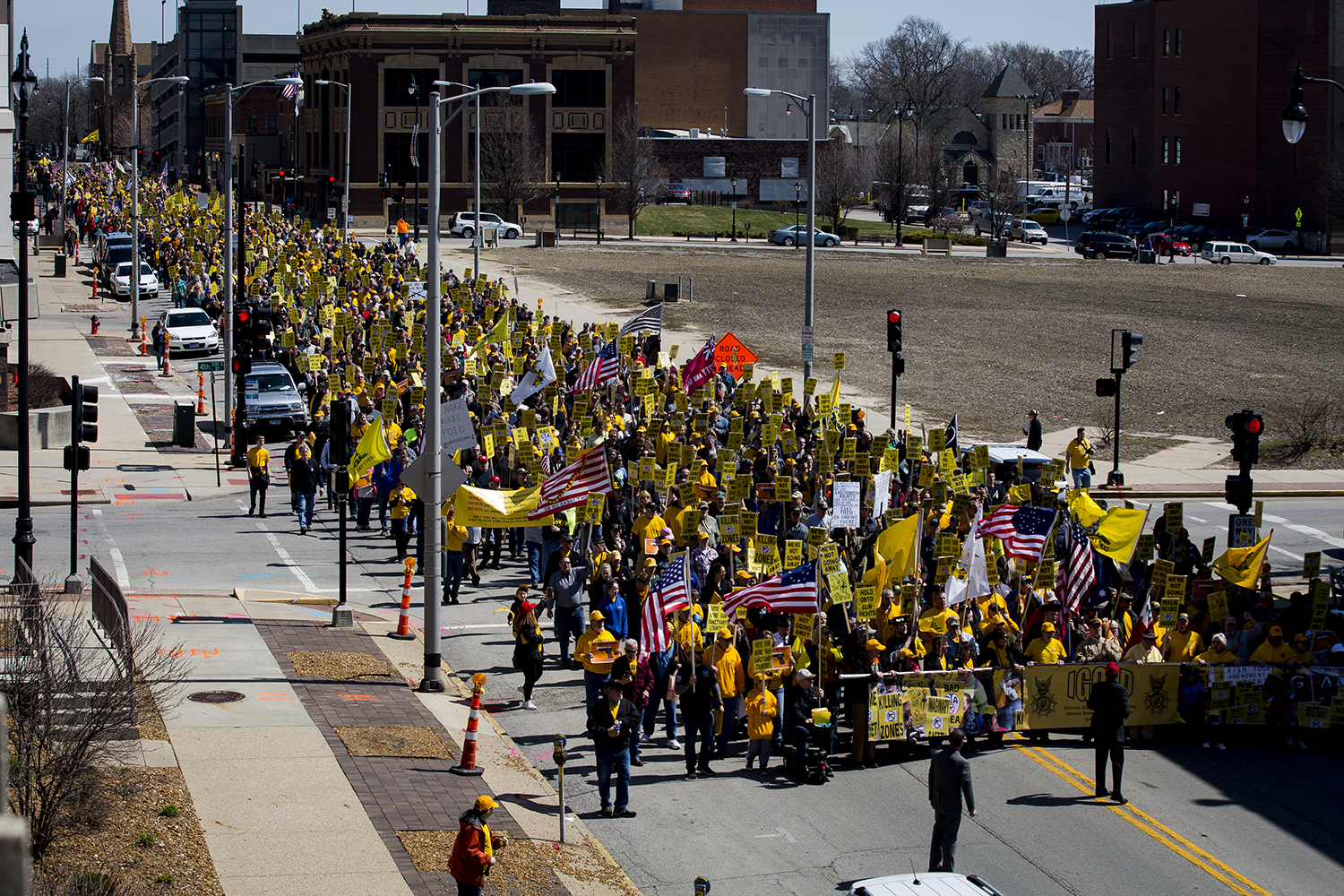 Gun rights advocates walk in the Illinois State Rifle Association's annual gun owner's lobby day (IGOLD) march to the Capitol Wednesday, March 27, 2019 in Springfield, Ill. [Rich Saal/The State Journal-Register]