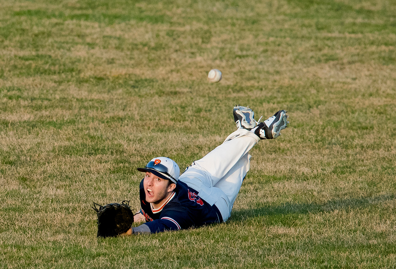Rochester's David Yoggerst dives for pop fly at Robin Roberts Stadium Wednesday, March 27, 2019. [Ted Schurter/The State Journal-Register]
