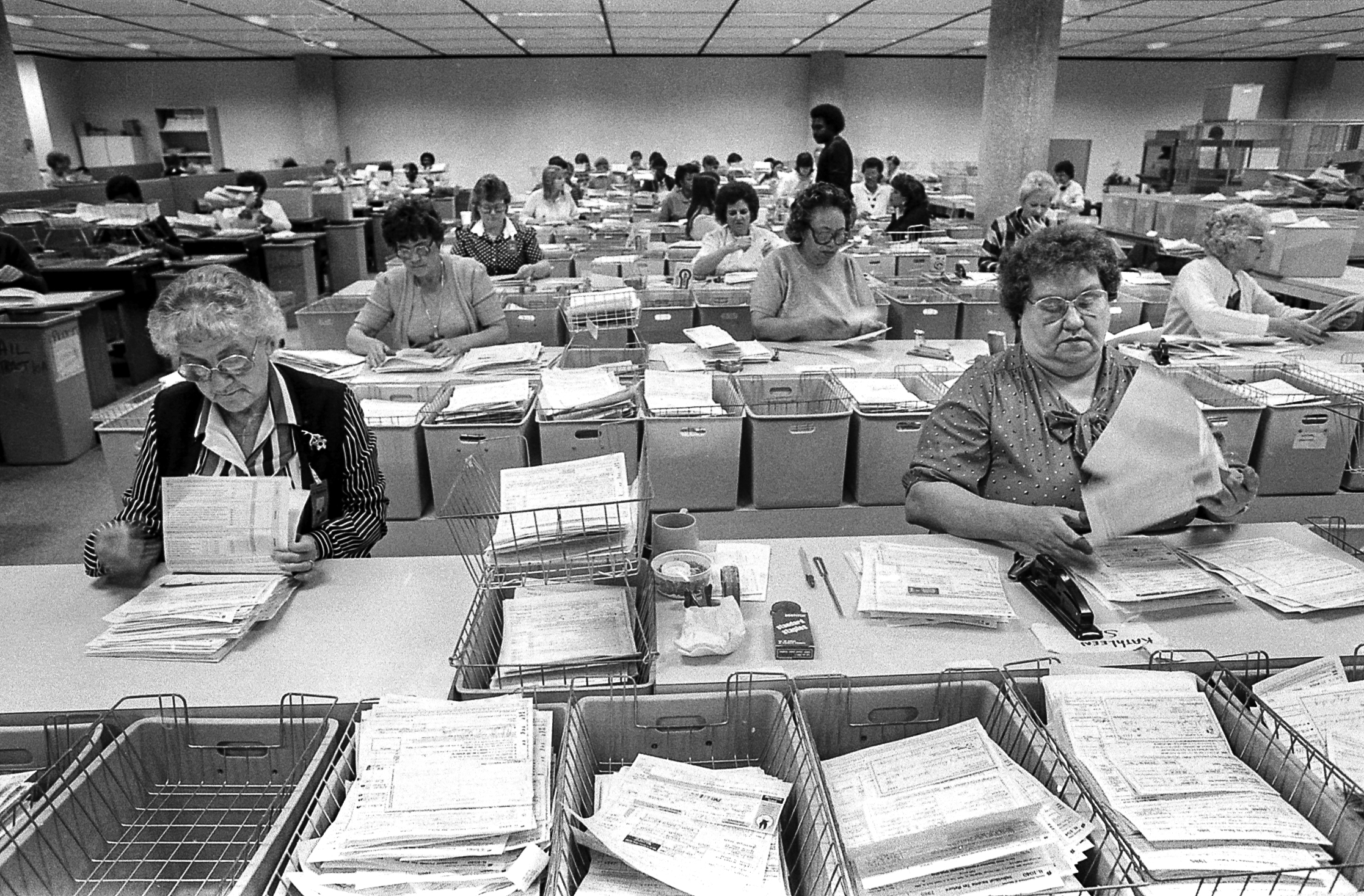 State employees processing tax returns at the Illinois Department of Revenue in April, 1986. File/David Klobucar/The State Journal-Register 
