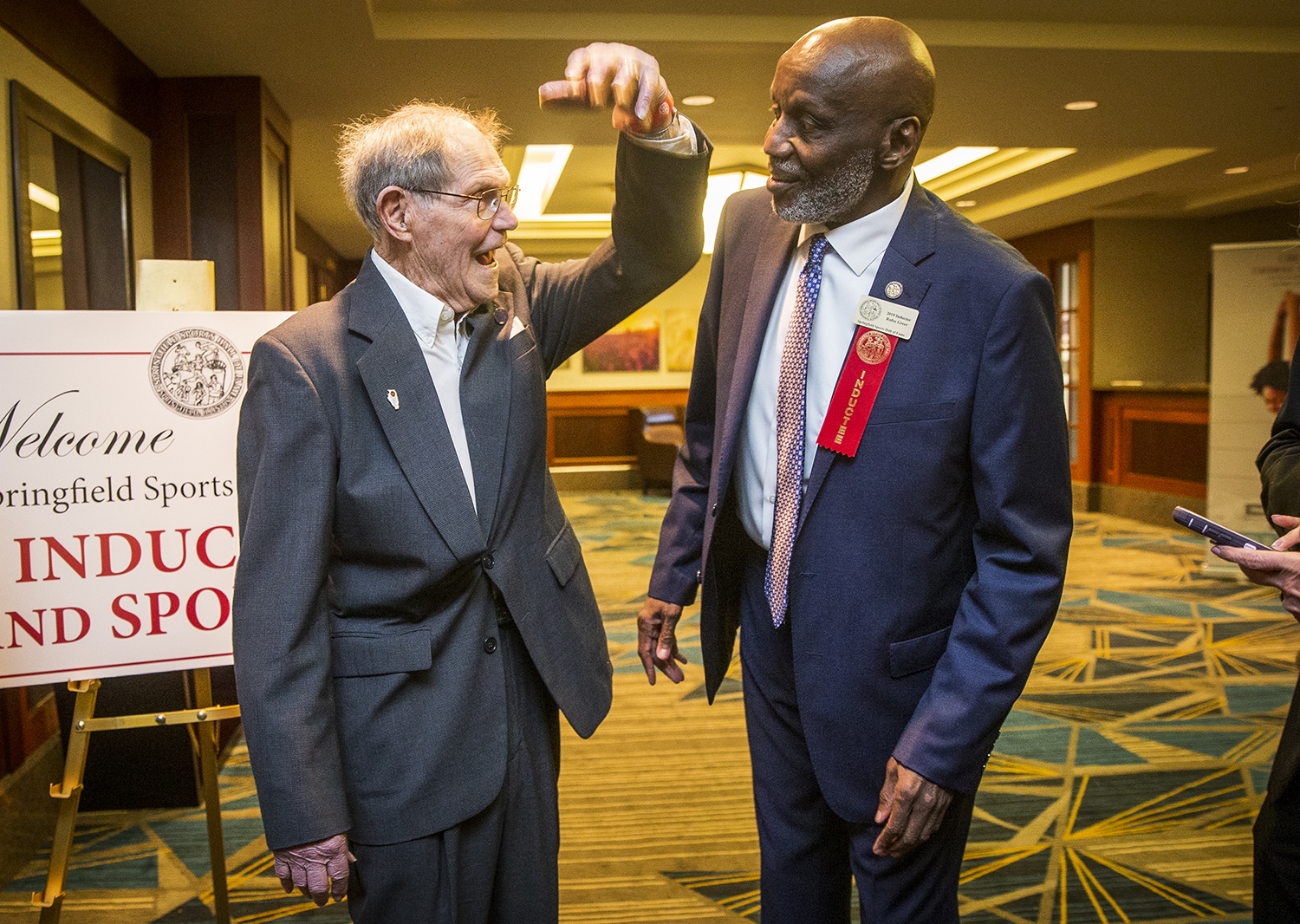 Rufus Greer, right, a 2019 Springfield Sports Hall of Fame inductee and 1971 Lanphier graduate, reminiscences with his former coach Arlyn Lober, left, during the 29th annual Springfield Sports Hall of Fame Banquet and Induction Ceremonies at the Crowne Plaza, Monday, April 8, 2019, in Springfield, Ill. [Justin L. Fowler/The State Journal-Register]