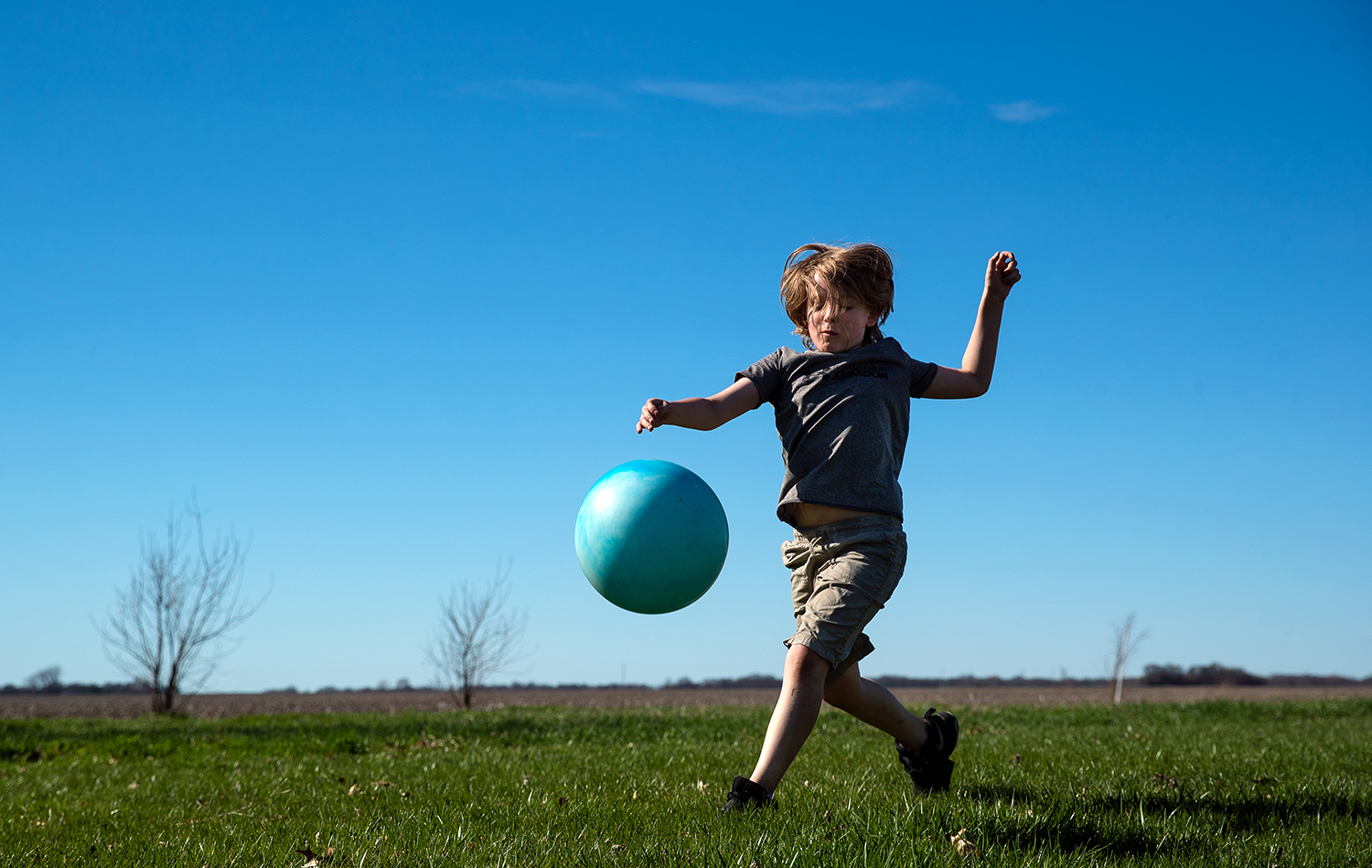 John Noble runs down a ball as he plays a game with his dad in the yard of their rural Pleasant Plains in the abundant sunshine Monday, April 8, 2019. [Ted Schurter/The State Journal-Register]