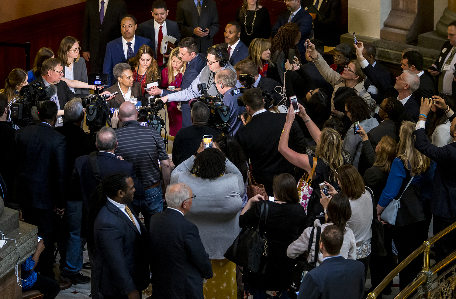 Chicago Mayor-elect Lori Lightfoot answers questions from the media as members of the public take photos with their cellphones in the rotunda at the Illinois State Capitol, Wednesday, April 10, 2019, in Springfield, Ill. [Justin L. Fowler/The State Journal-Register]