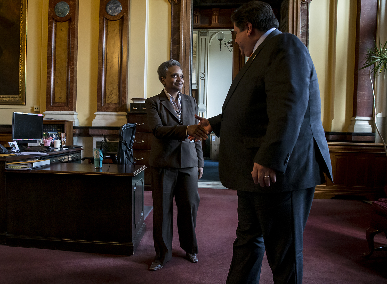 Chicago Mayor-elect Lori Lightfoot shakes hands with Illinois Governor J.B. Pritzker after they held a meeting together in his offices at the Illinois State Capitol, Wednesday, April 10, 2019, in Springfield, Ill. [Justin L. Fowler/The State Journal-Register]