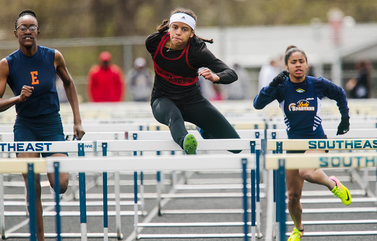 Springfield's Lauren Ferguson finishes third in the 100 hurdles during the 2019 Thomas McBride Invitational at Southeast High School Saturday, April 13, 2019. [Ted Schurter/The State Journal-Register]